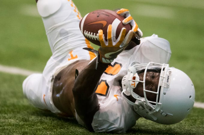 Tennessee wide receiver Jordan Murphy (11) slides for the ball during UT Vols preseason football practice Wednesday, Aug. 8, 2018.