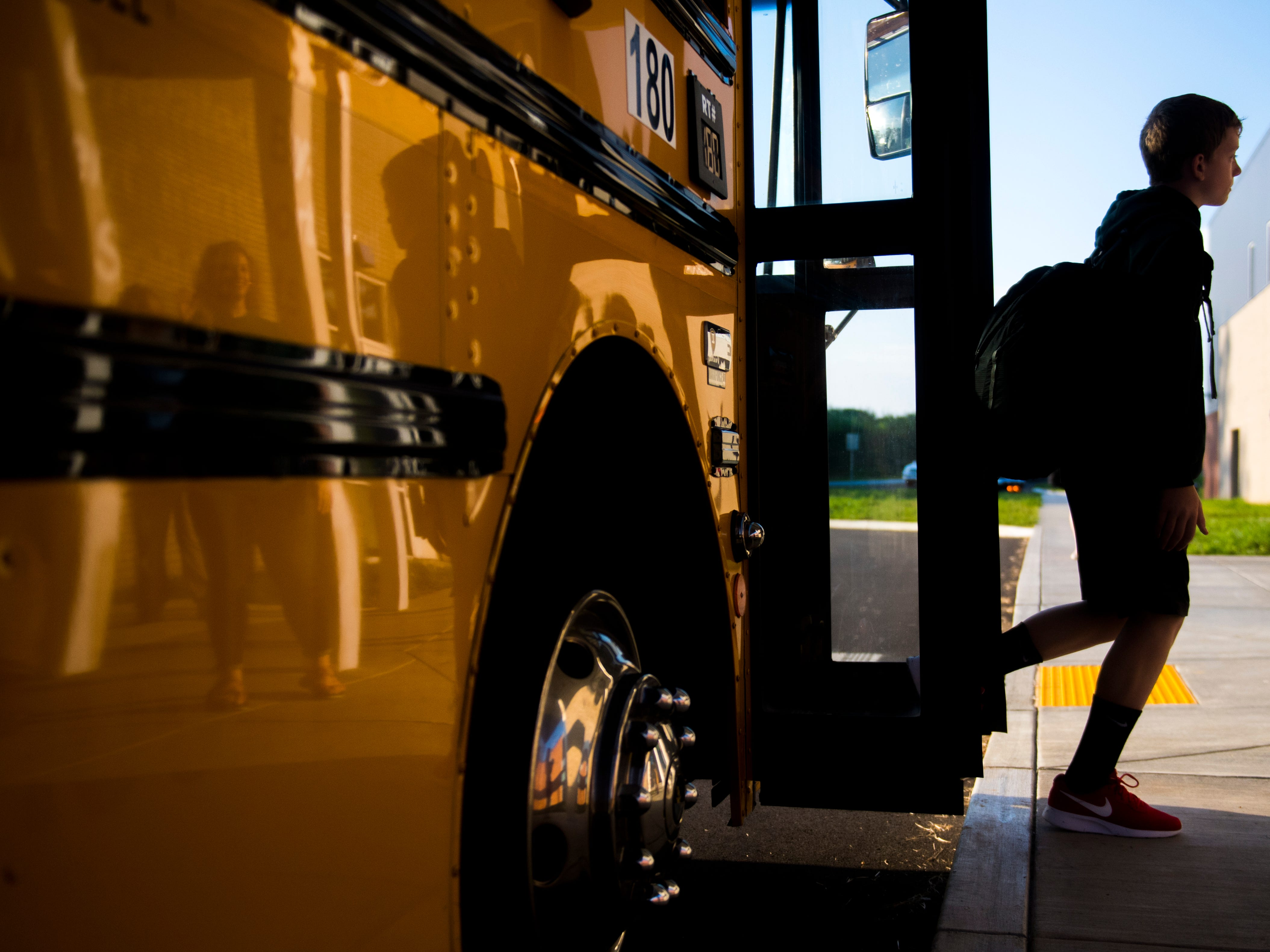 Students step off the bus to enter the new Gibbs Middle School for the first day of school on Wednesday, August 8, 2018.
