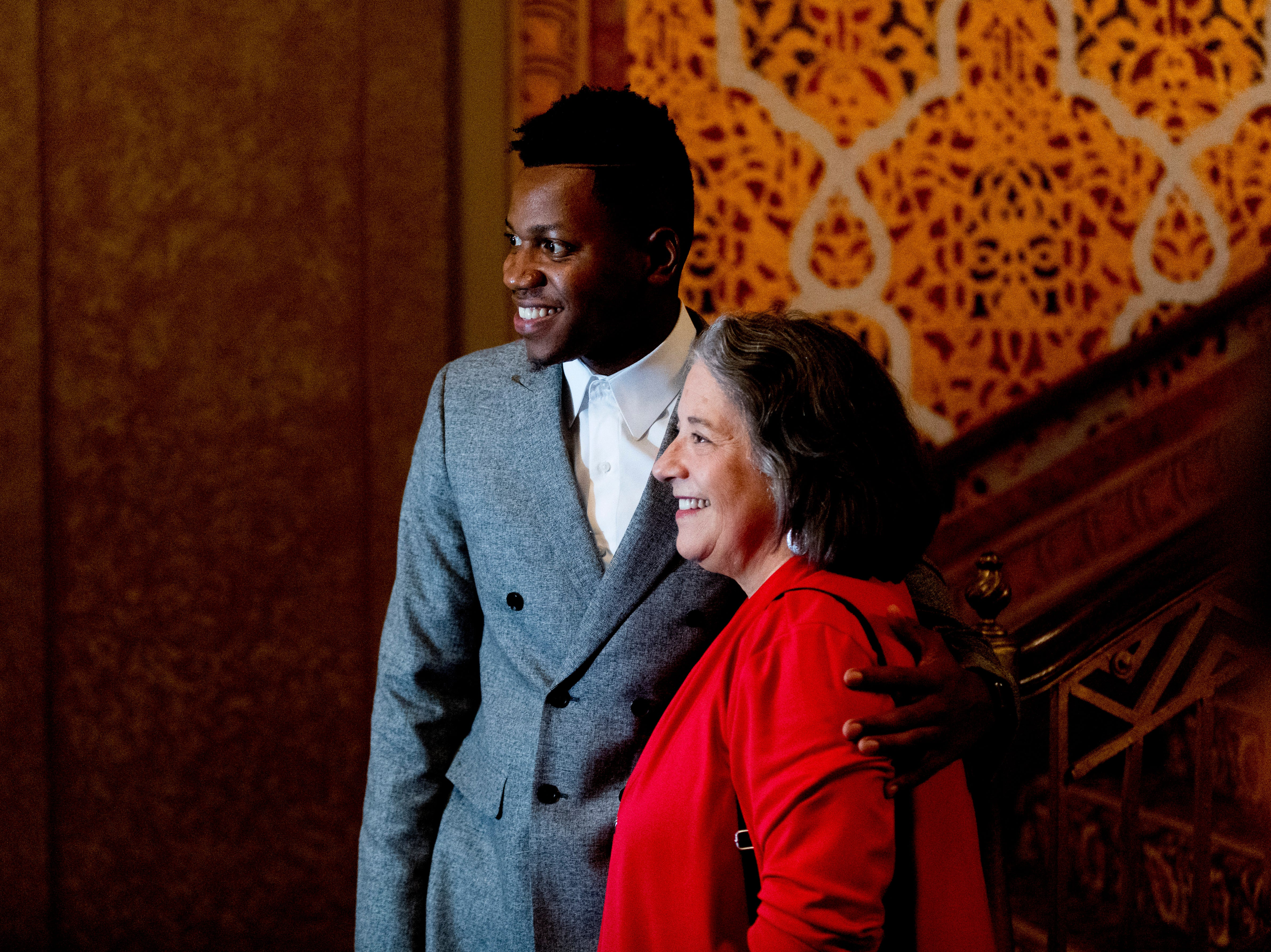 """Chris Blue takes a photo with Knoxville Mayor Madeline Rogero at the Beck Cultural Center's """"Eighth of August"""" commemoration at the Tennessee Theatre in Knoxville, Tennessee on Wednesday, August 8, 2018. Filmmaker Loki Mulholland and civil rights icon Joan Trumpauer Mulholland were special guests at the debut screening of Black, White & U.S."""