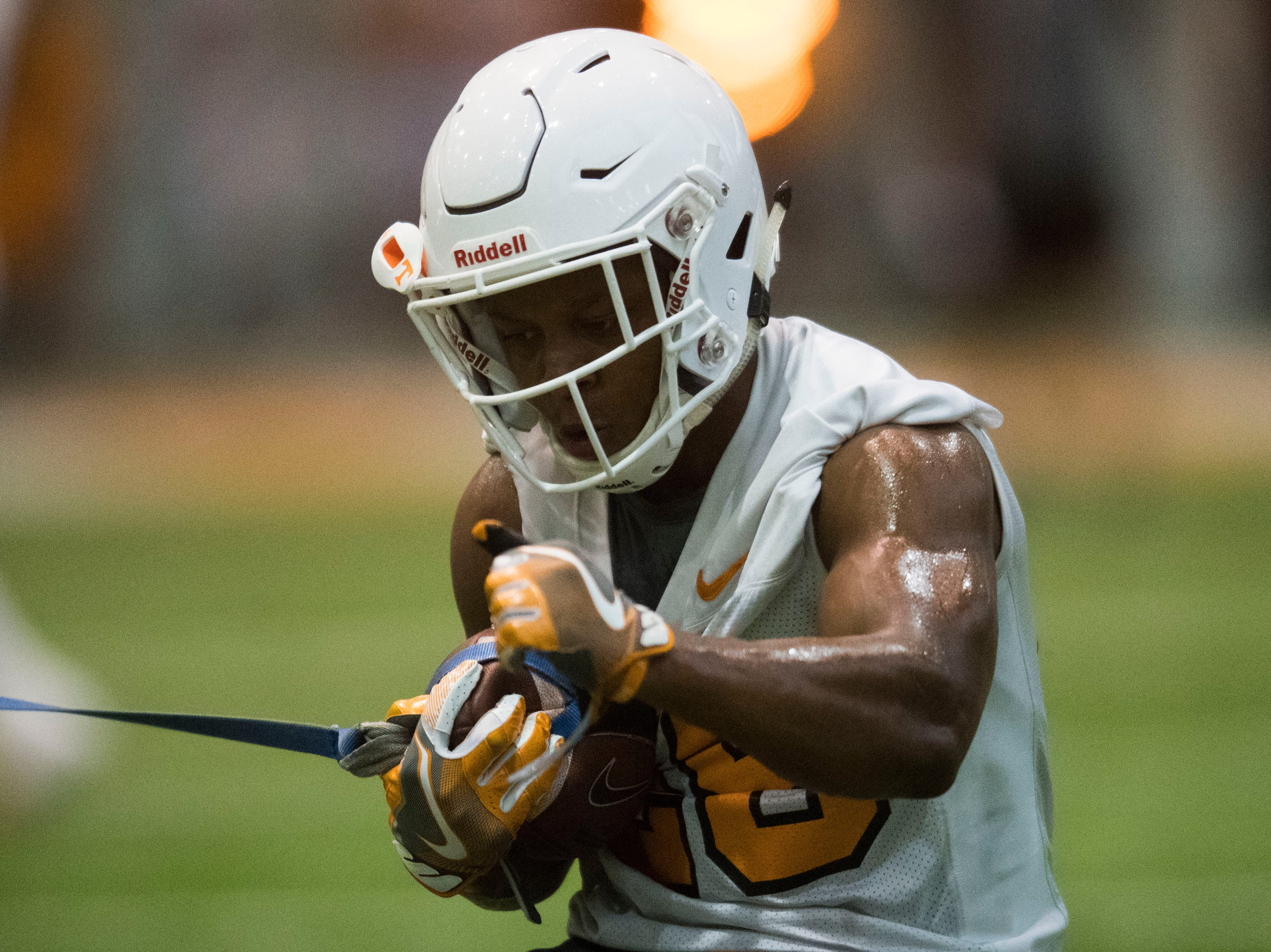 Tennessee running back James Christian (28) runs with the ball during UT Vols preseason football practice Wednesday, Aug. 8, 2018.