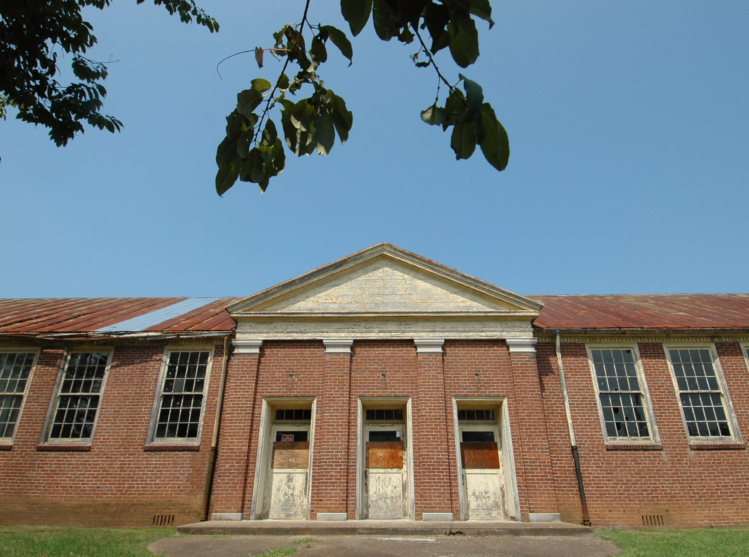 TRACEY TRUMBULL/NEWS SENTINEL 080107 WEDNESDAY - Knox County has more than several older school buildings that go unused and have fallen in to differing states of disrepair. Boarded doors and broken windows  display the plight of the Old South High School in south Knoxville.