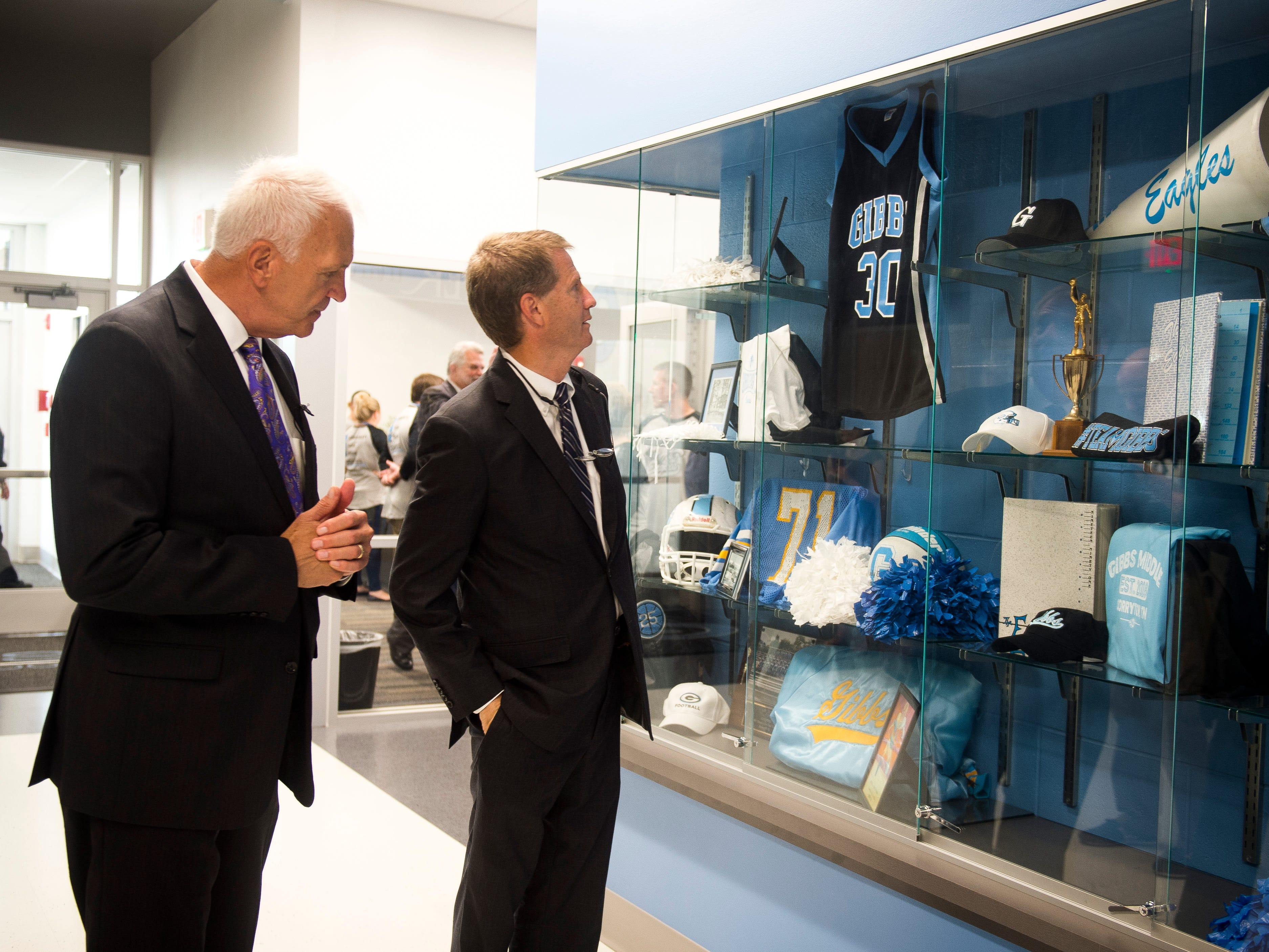 Knox County Schools superintendent Bob Thomas, left, and Knox County Mayor Tim Burchett, right, check out memorabilia displayed inside the new Gibbs Middle School on the first day of school on Wednesday, August 8, 2018.