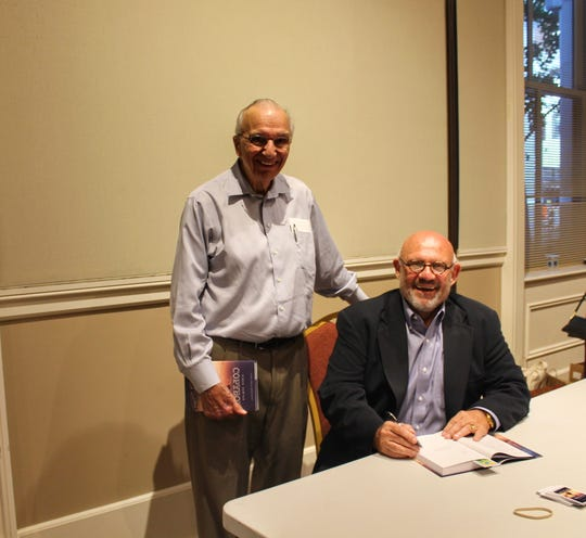 Vince Vawter, right, poses with retired Knoxville News Sentinel editor Harry Moskos at an event on Tuesday, Aug. 7, 2018, at the East Tennessee History Center.
