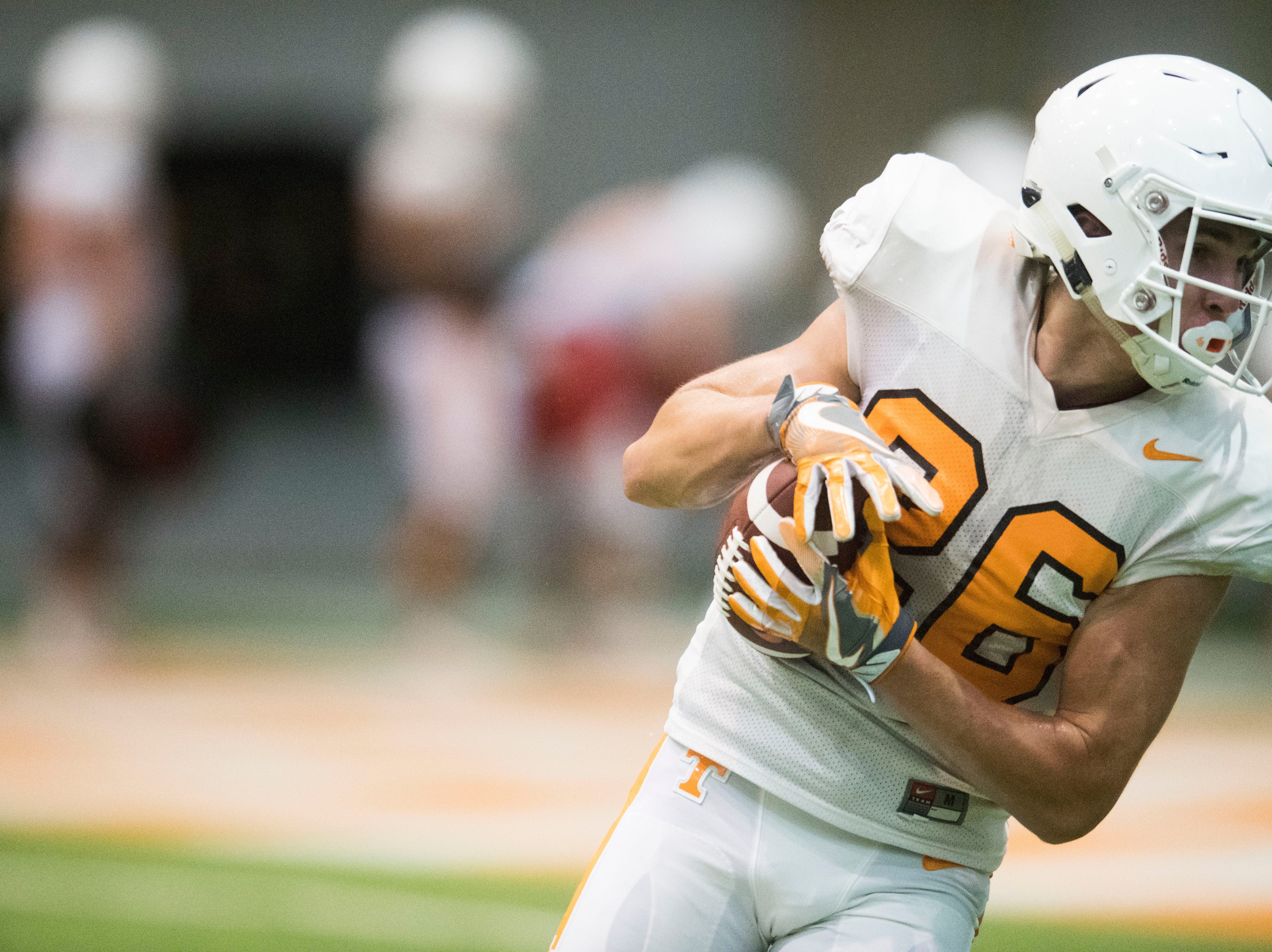 Tennessee wide receiver Jay Shoop (26) runs with the ball during UT Vols preseason football practice Wednesday, Aug. 8, 2018.