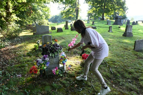 Angie Kliebert heard the news the day Paula K. Dyer was killed and wanted to bring a small flower for her grave at  Glenwood Cemetery Wednesday, August 8, 2018. Dyer was raped and murdered by Billy Ray Irick who is scheduled to be executed Thursday.