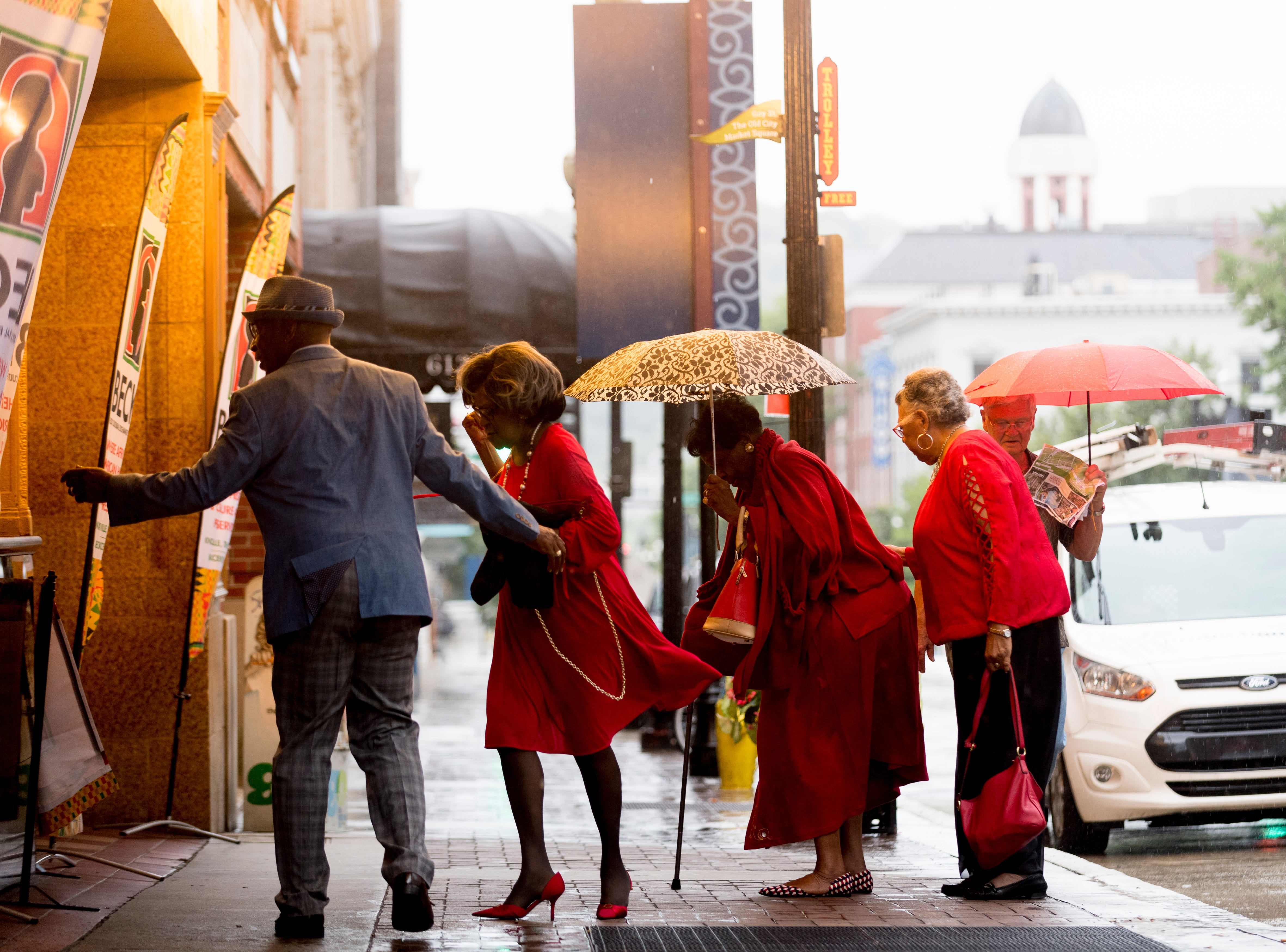 """Attendees arrive at the Beck Cultural Center's """"Eighth of August"""" commemoration at the Tennessee Theatre in Knoxville, Tennessee on Wednesday, August 8, 2018. Filmmaker Loki Mulholland and civil rights icon Joan Trumpauer Mulholland were special guests at the debut screening of Black, White & U.S."""