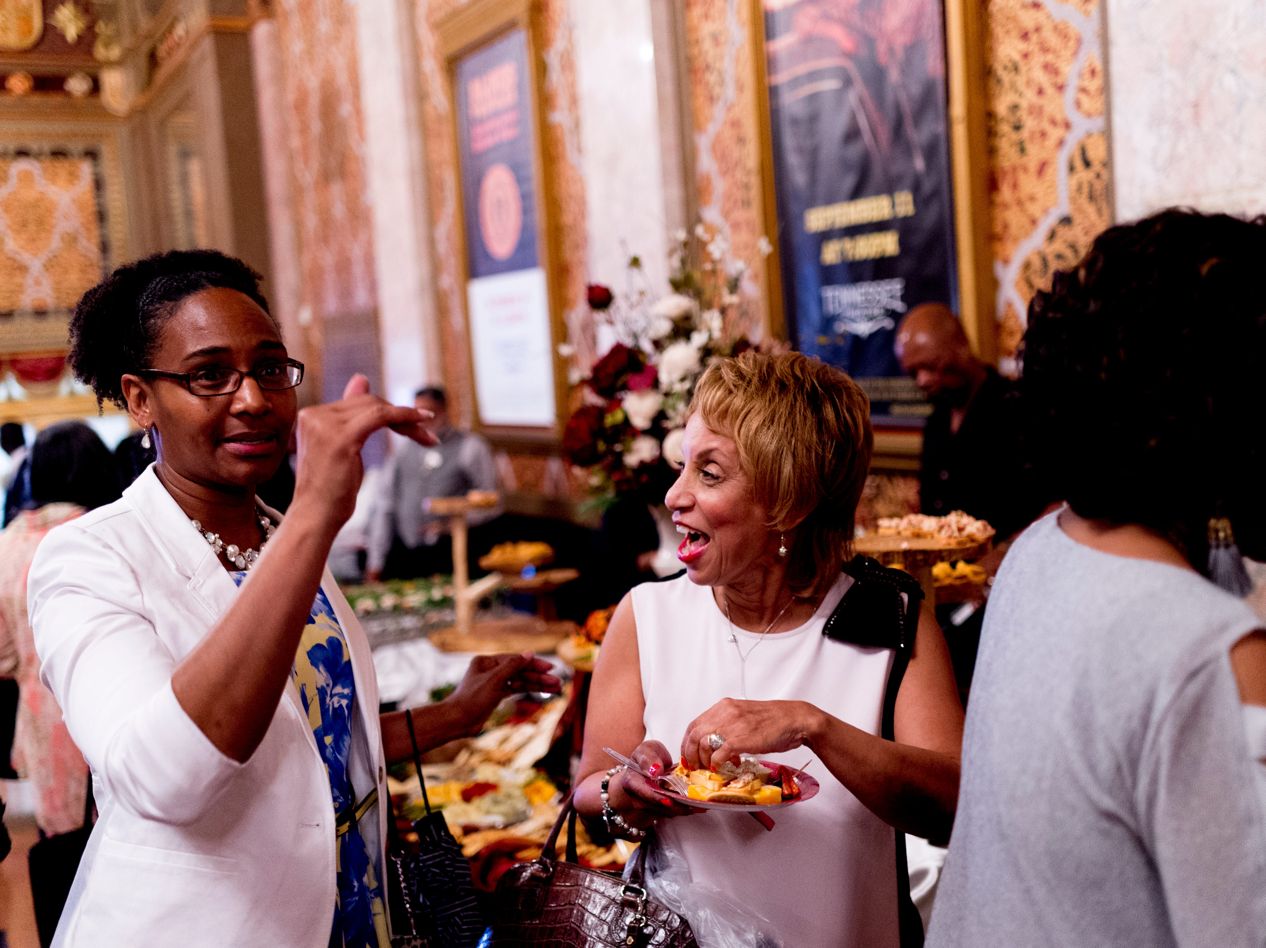 """Attendees share a laugh at the Beck Cultural Center's """"Eighth of August"""" commemoration at the Tennessee Theatre in Knoxville, Tennessee on Wednesday, August 8, 2018. Filmmaker Loki Mulholland and civil rights icon Joan Trumpauer Mulholland were special guests at the debut screening of Black, White & U.S."""