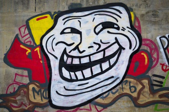 Troll face internet meme.