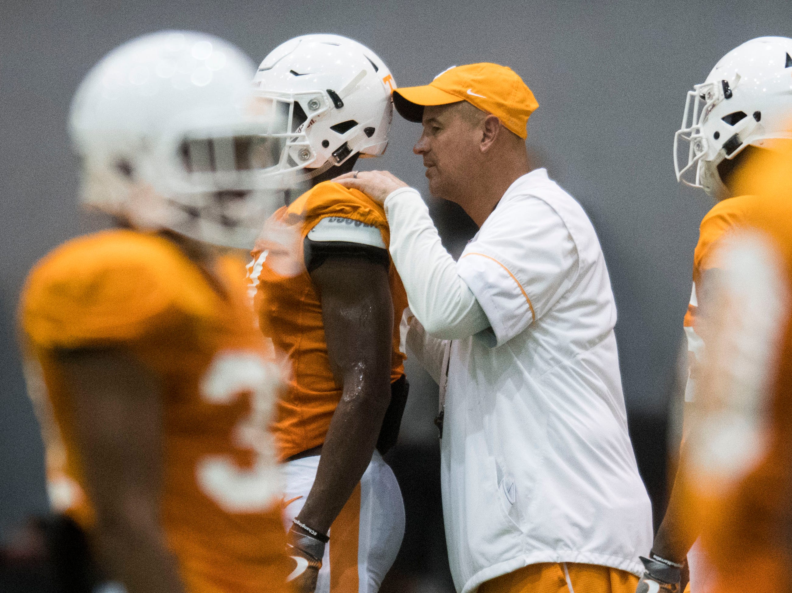 Tennessee Head Coach Jeremy Pruitt coaches a player during UT Vols preseason football practice Wednesday, Aug. 8, 2018.