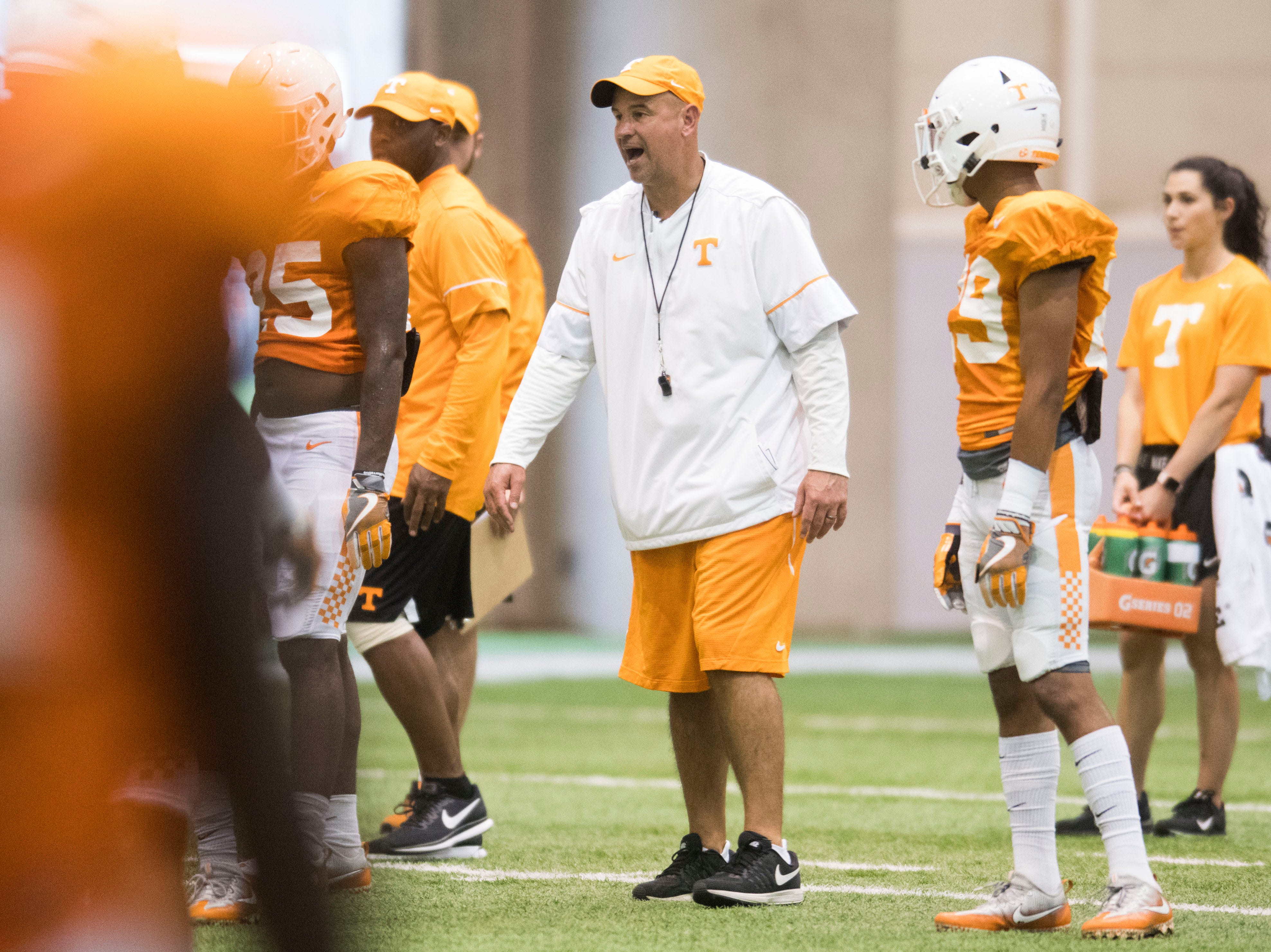Tennessee Head Coach Jeremy Pruitt coaches on the field during UT Vols preseason football practice Wednesday, Aug. 8, 2018.