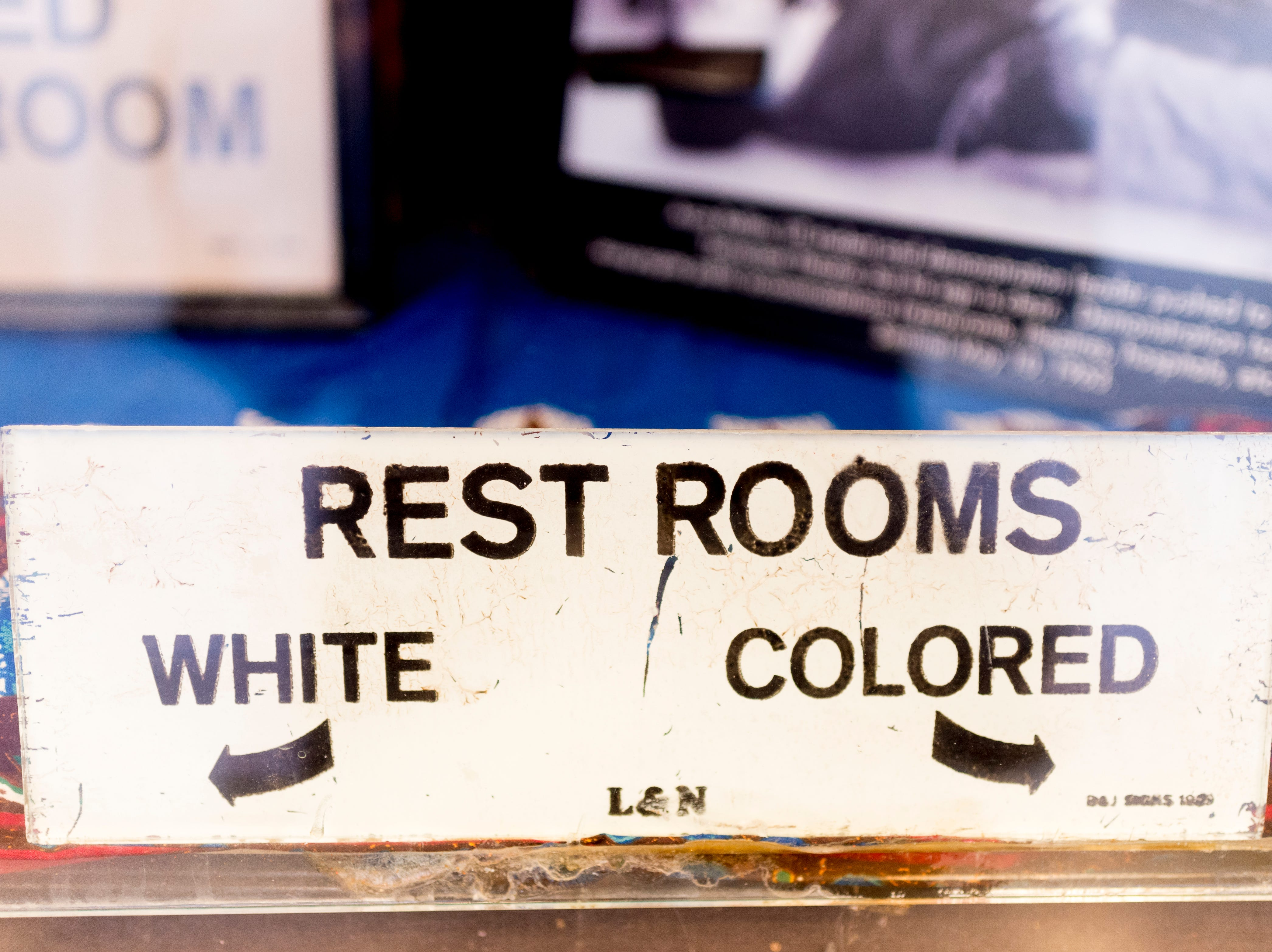 """A restroom sign from an L&N Railroad building at the Beck Cultural Center's """"Eighth of August"""" commemoration at the Tennessee Theatre in Knoxville, Tennessee on Wednesday, August 8, 2018. Filmmaker Loki Mulholland and civil rights icon Joan Trumpauer Mulholland were special guests at the debut screening of Black, White & U.S."""