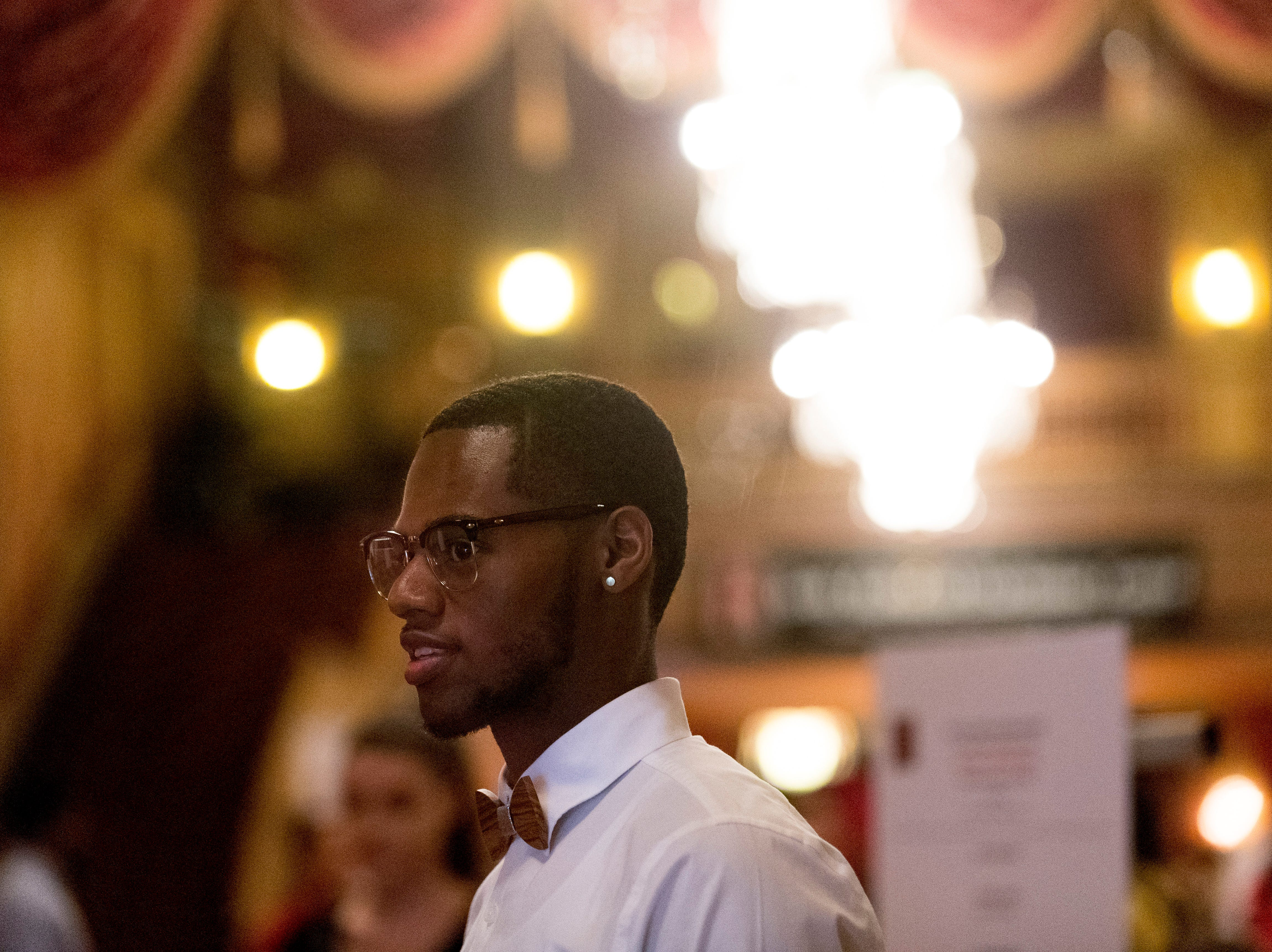 """Kwanbe Bullard welcomes guests at the Beck Cultural Center's """"Eighth of August"""" commemoration at the Tennessee Theatre in Knoxville, Tennessee on Wednesday, August 8, 2018. Filmmaker Loki Mulholland and civil rights icon Joan Trumpauer Mulholland were special guests at the debut screening of Black, White & U.S."""