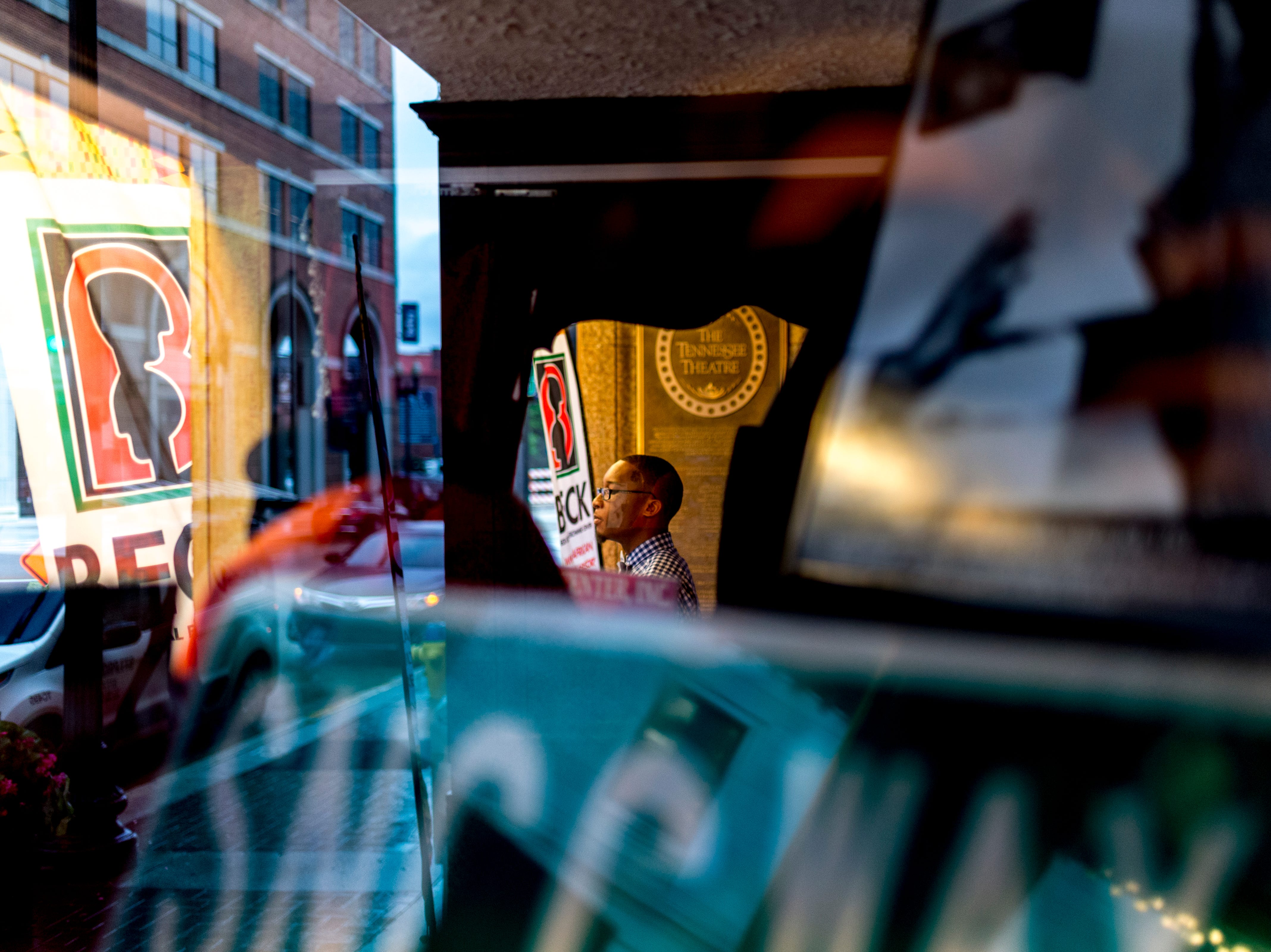 """An attendee waits outside at the Beck Cultural Center's """"Eighth of August"""" commemoration at the Tennessee Theatre in Knoxville, Tennessee on Wednesday, August 8, 2018. Filmmaker Loki Mulholland and civil rights icon Joan Trumpauer Mulholland were special guests at the debut screening of Black, White & U.S."""
