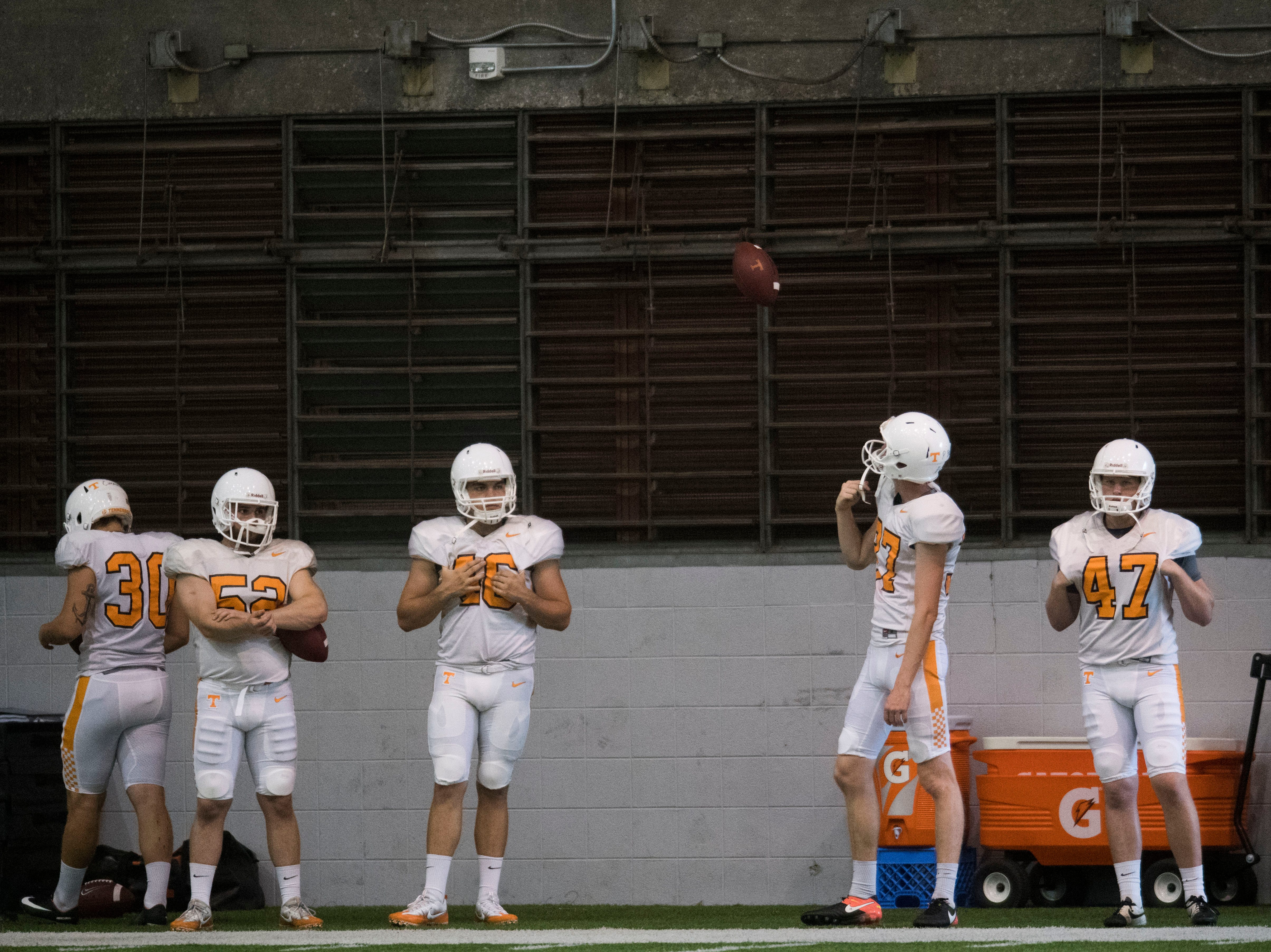 Players stand on the sidelines during UT Vols preseason football practice Wednesday, Aug. 8, 2018.