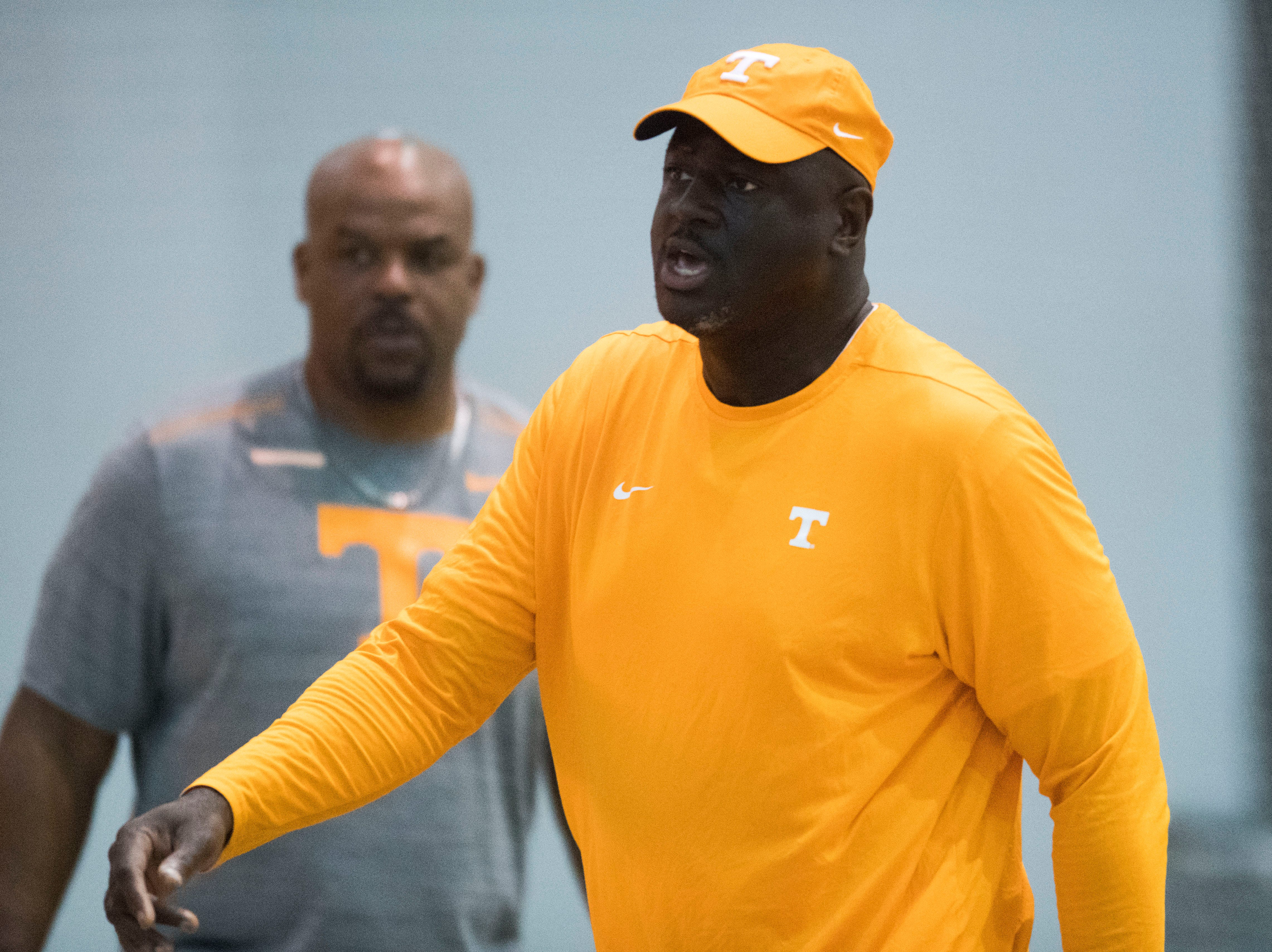 Co-defensive coordinator and outside linebackers coach Chris Rump walks on the field during UT Vols preseason football practice Wednesday, Aug. 8, 2018.
