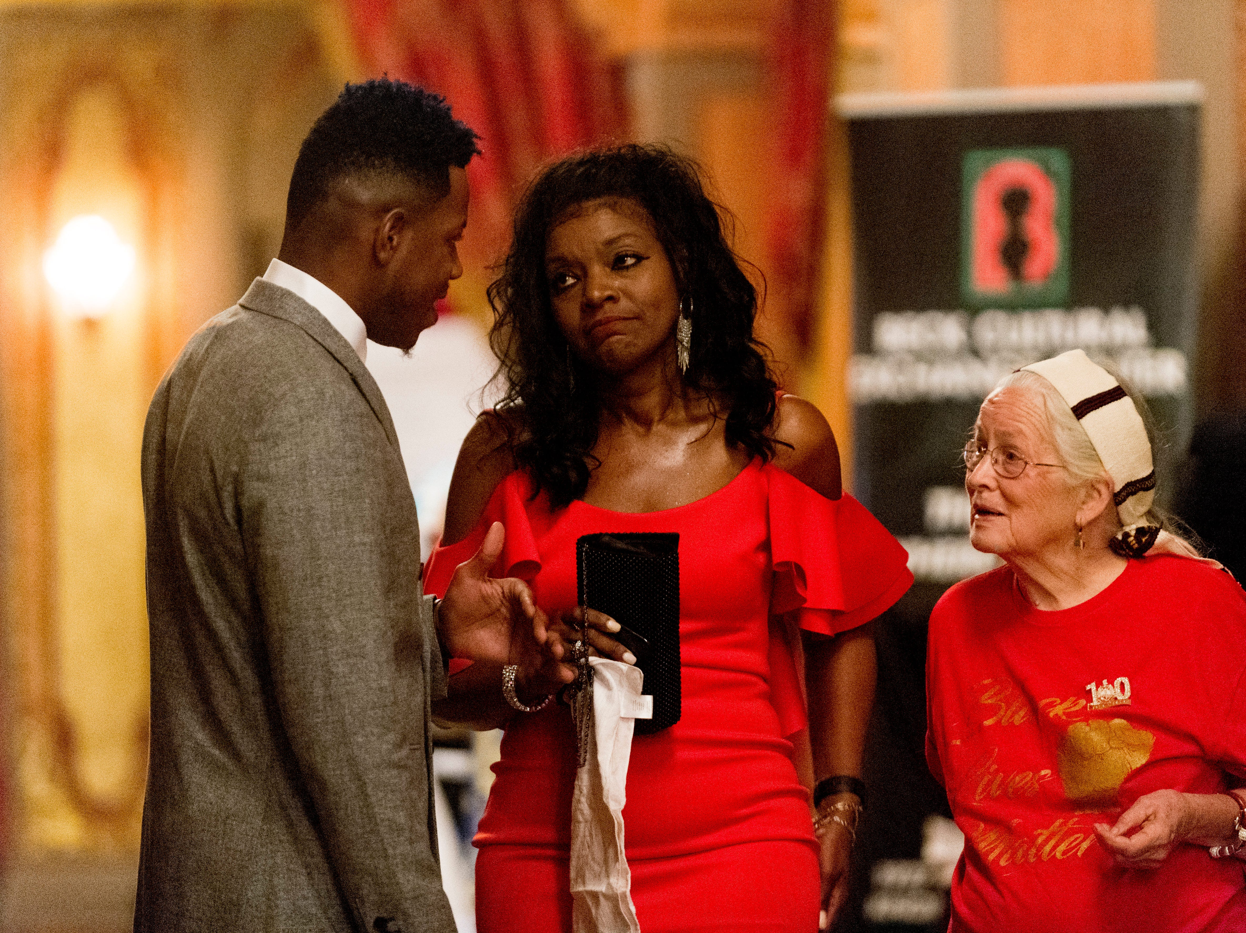 """From left, Chris Blue, Renee Kesler, President of the Beck Cultural Center, and civil rights icon Joan Trumpauer Mulholland chat at the Beck Cultural Center's """"Eighth of August"""" commemoration at the Tennessee Theatre in Knoxville, Tennessee on Wednesday, August 8, 2018. Filmmaker Loki Mulholland and civil rights icon Joan Trumpauer Mulholland were special guests at the debut screening of Black, White & U.S."""