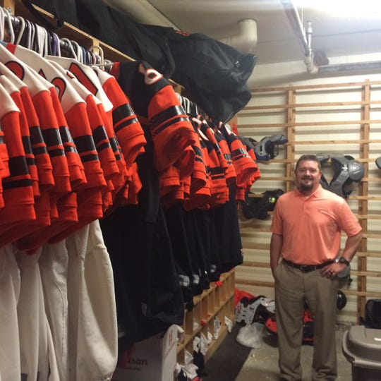 When he makes it down to the football equipment room, Chad Smith feels right at home after 14 years on the sidelines.