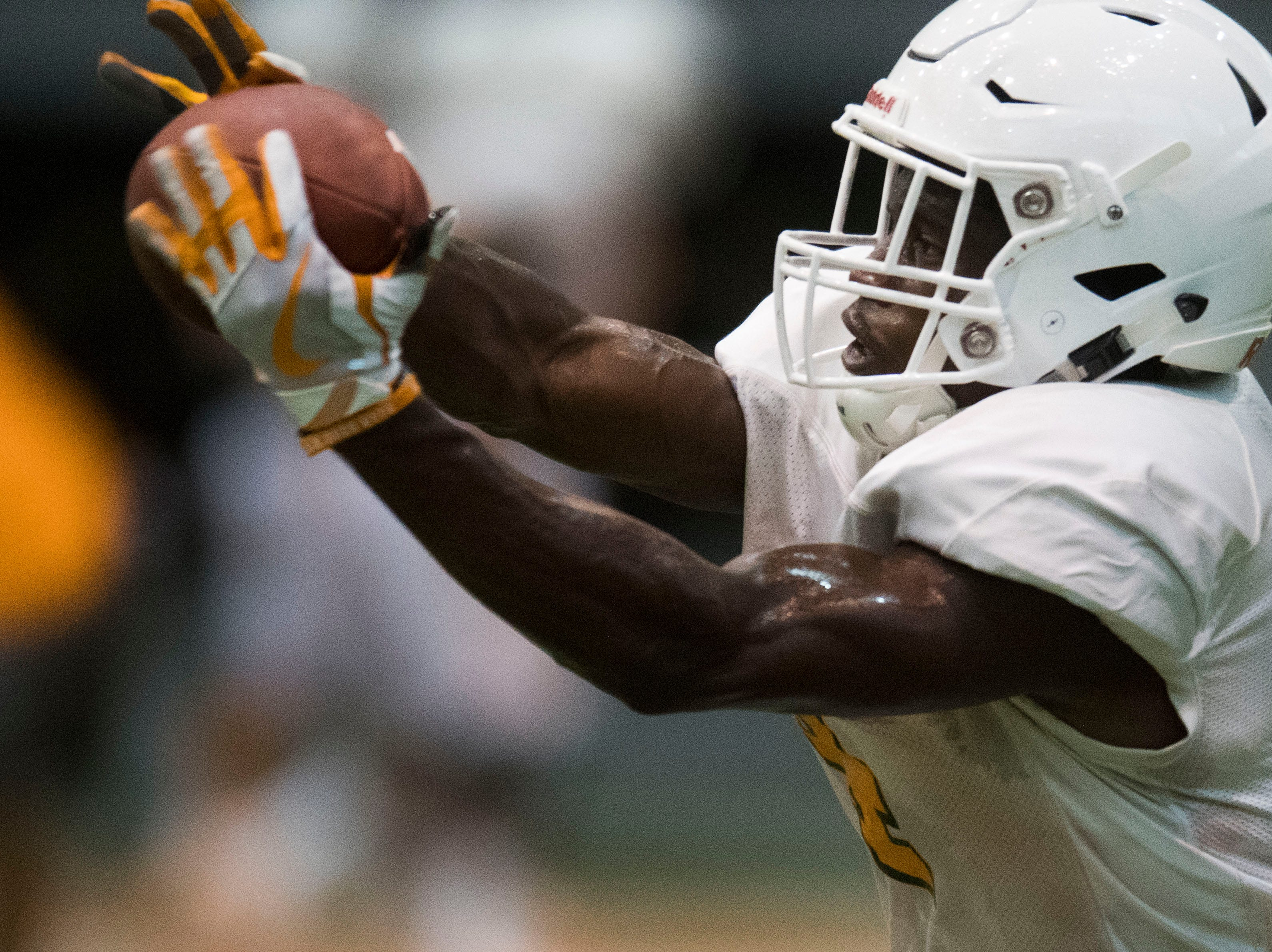 Tennessee player Bart Harris (4) catches a ball during UT Vols preseason football practice Wednesday, Aug. 8, 2018.