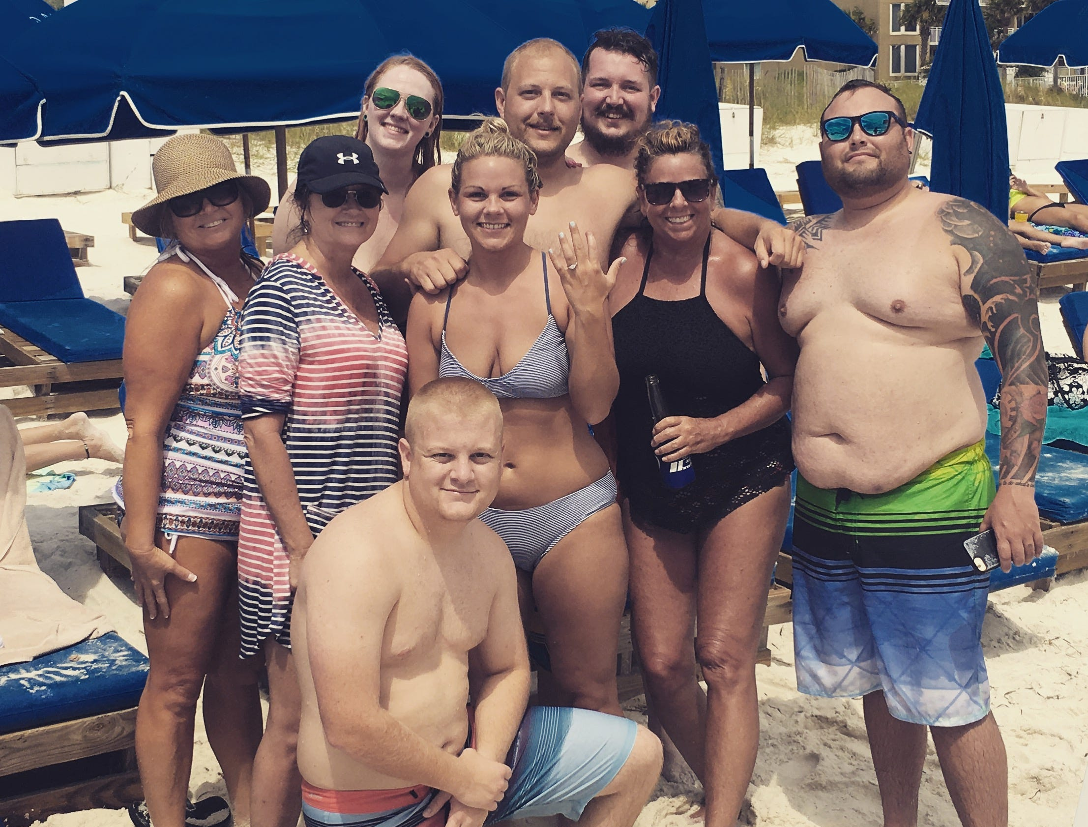 Cassandra Arn, center, and her friends pose for a photo Aug. 3, 2018, after she got engaged on the beach in Panama City, Florida. Her boyfriend, Taylor Farrar, decided to drop to his knee immediately after his lost engagement ring was returned.