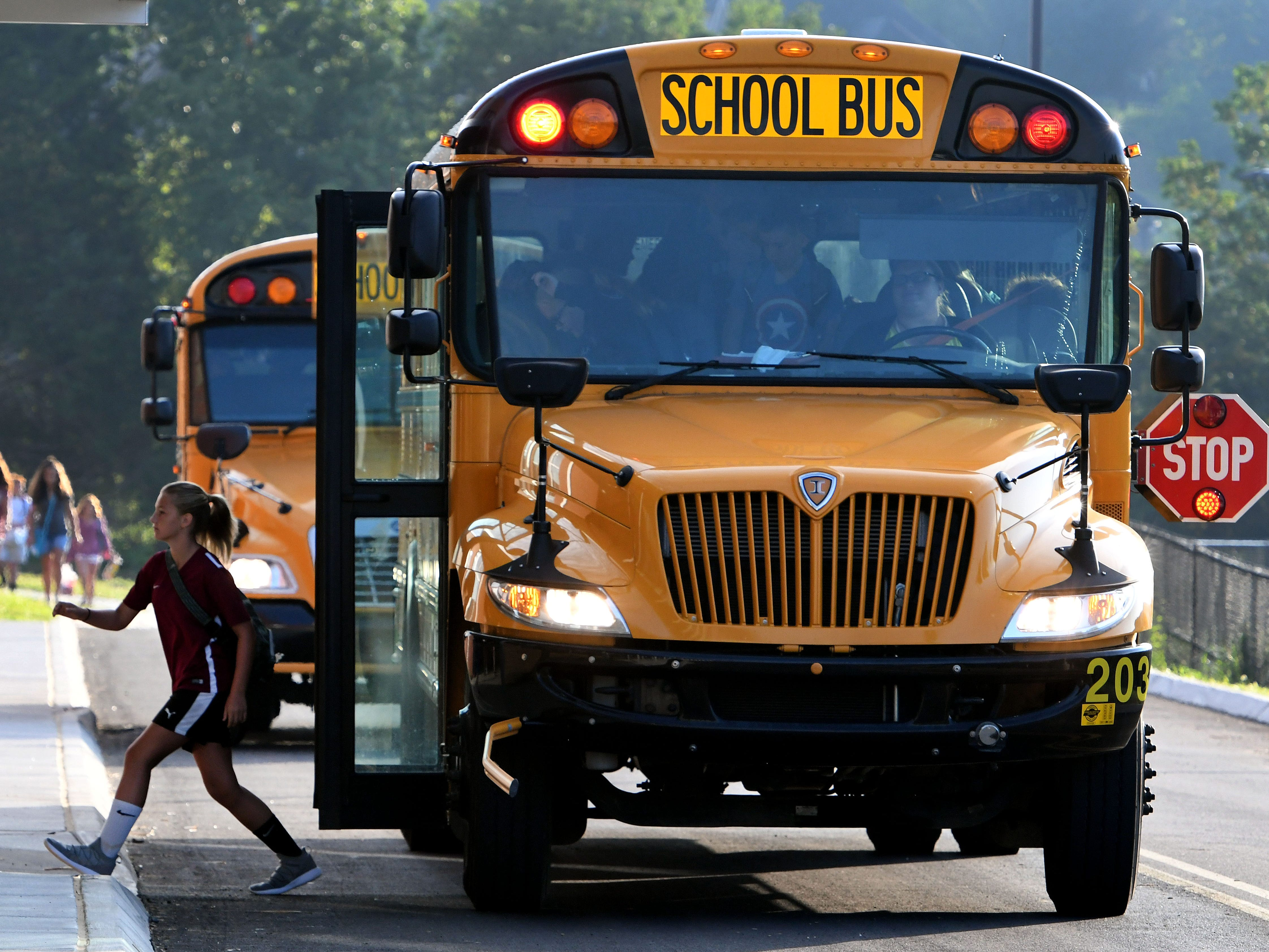 Students arriving by bus for the first day of school at Hardin Valley Middle School Wednesday, August 8, 2018. Principal Cory Smith directed teachers and students to a smooth opening for the new school.
