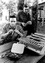 Johnny Cash and country singer Johnny Horton prepared to go fishing in Arkansas in 1959.