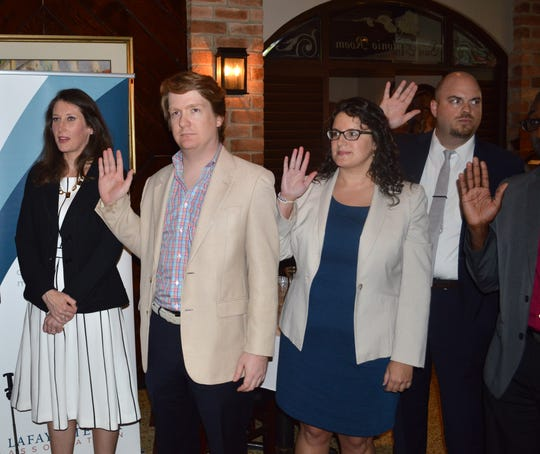 Officers of the LBA's Young Lawyers Section are sworn in at the officers installation banquet on Aug. 2.