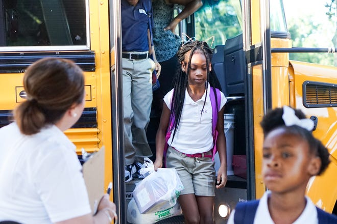 J.W. Faulk Elementary students arrive for their first day of school in this file photo.