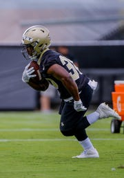 New Orleans Saints running back Boston Scott (30) participates in drills June 12 during minicamp at the Ochsner Sports Performance Center.