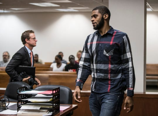 Chane Behanan approaches the bench in court Wednesday.