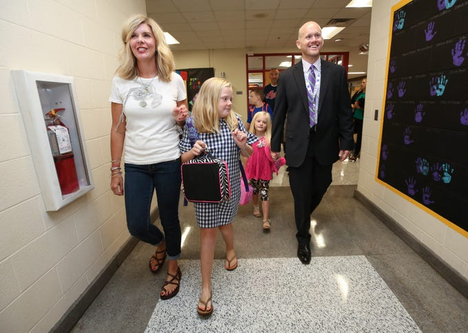 (Right to Left)  New Bullitt County Superintendent of Schools Jesse Bacon walked his daughters Piper, 5, Nora, 9, and his wife Johna Bacon into the Pleasant Grove Elementary School in Mt. Washington on the first day of classes.  This is BaconÕs first year as superintendent. Aug. 8, 2018