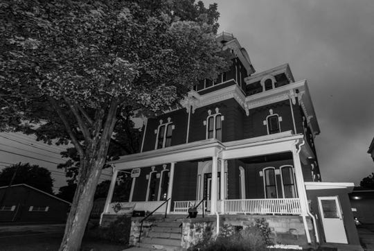 "The former Eaton County sheriff's residence/women's jail, that sits next to the 1885 Eaton County Courthouse in Charlotte, is just one of several ""haunted"" locations around Lansing that Jenn Carpenter's new book ""Haunted Lansing"" explores."