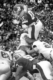 Hyland Hickson leaps over Notre Dame defenders for a touchdown in 1990 at Spartan Stadium.