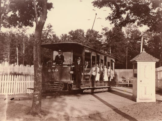 An open interurban streetcar (no. 249) with unidentified passengers and staff at the Waverly Park stop. A small ticket booth can be seen at right. The Lansing and Suburban Traction Co. had extended a line to the park in 1904, after obtaining the property the previous year and changing its name from Leadley's to Waverly Park.