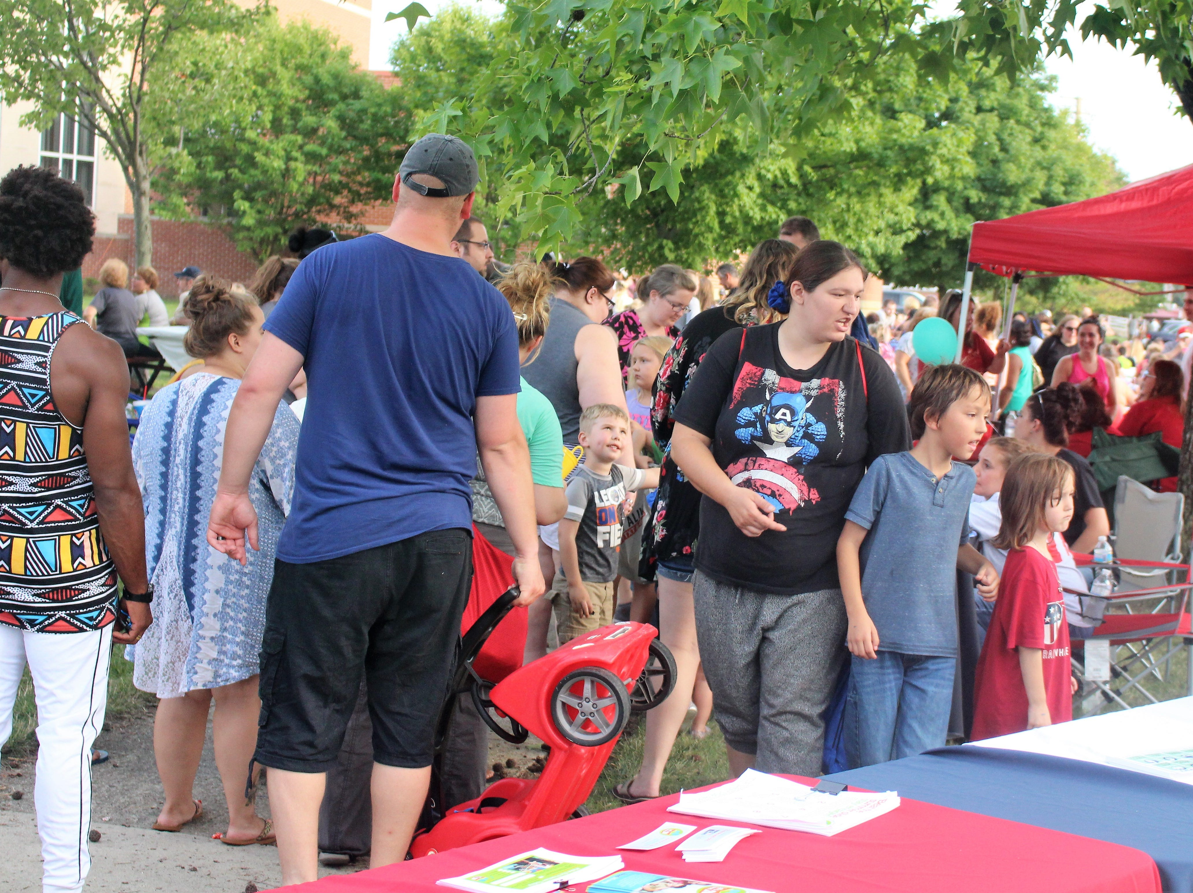 Marion residents visited food trucks as a live band played in the background at Grant Middle School on Tuesday.