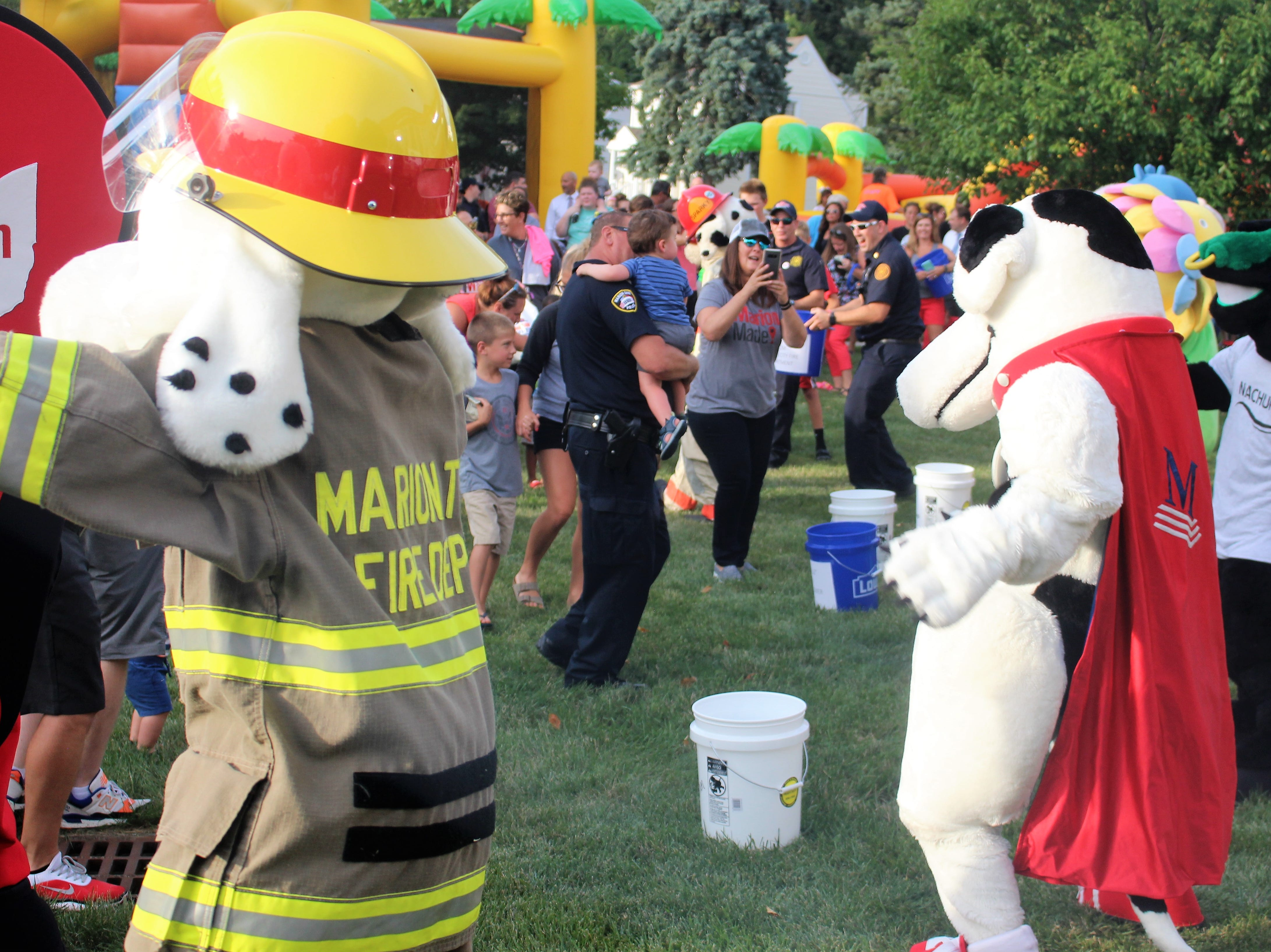 Mascots representing different organizations across town dance at Grant Middle School. Kingston representing Kingston Residence of Marion won the dance off on Tuesday.