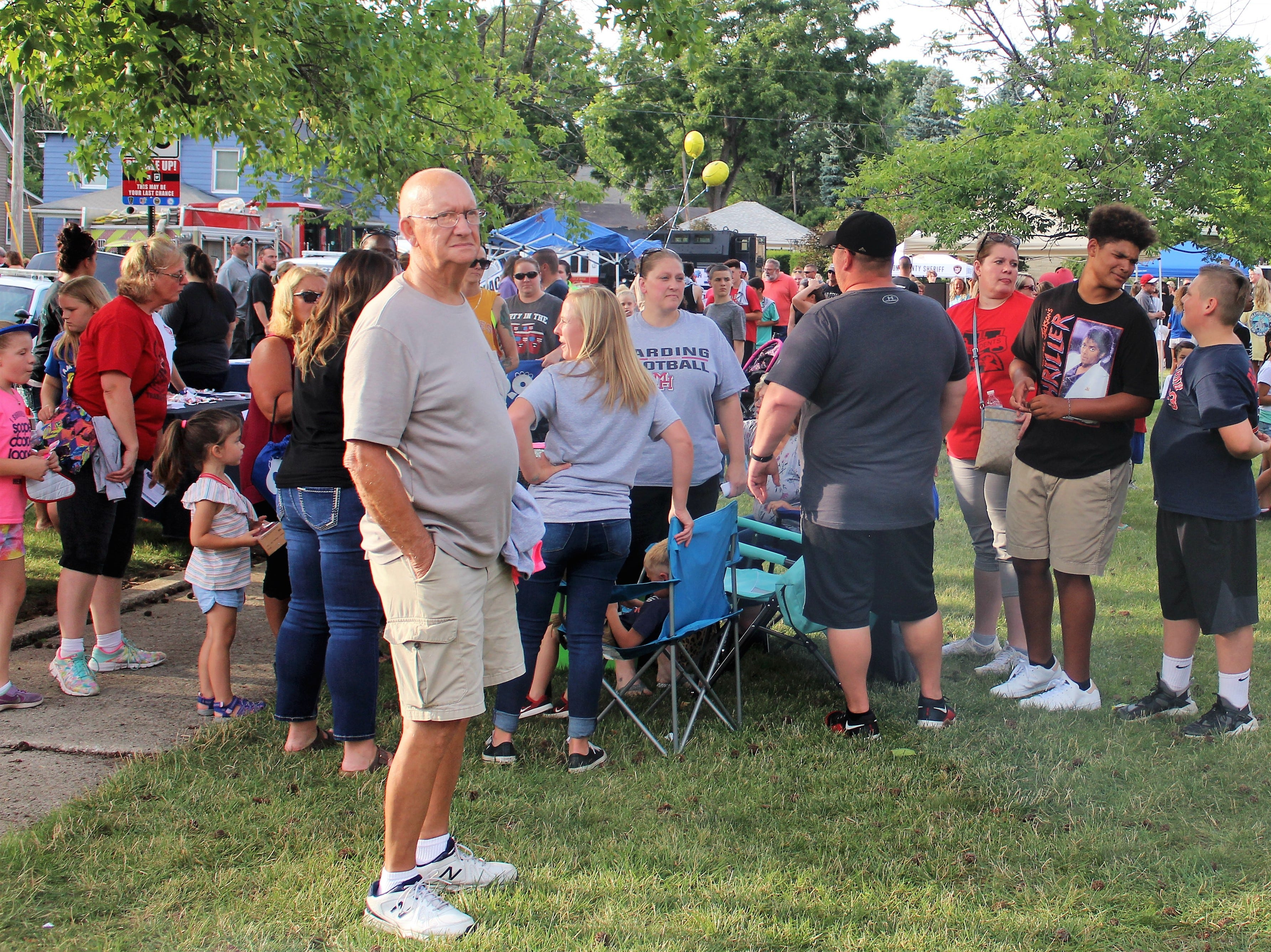 Marion residents frequented food trucks as a live band played in the background at Grant Middle School on Tuesday.