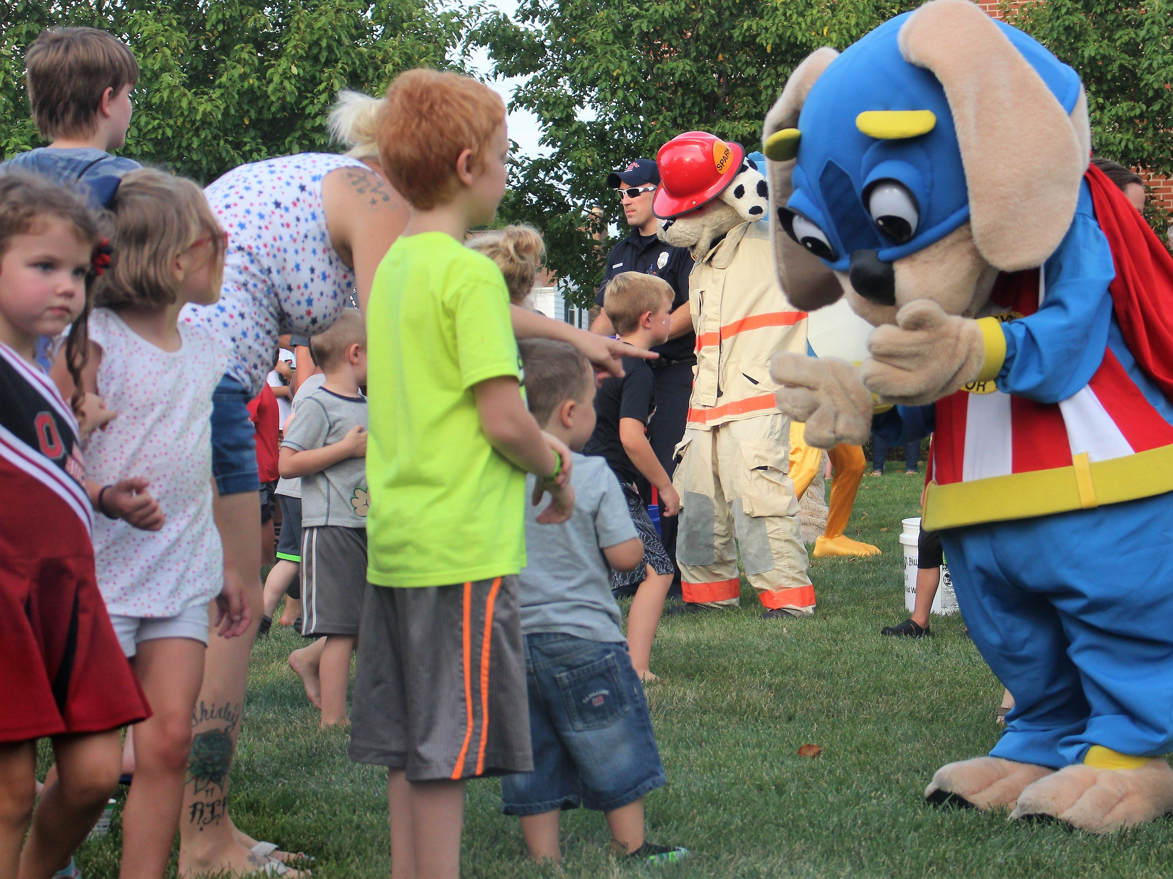 Safety Pup interacts with local children during the 5th annual National Night Out in Marion. Mascots representing different organizations around town danced off on Tuesday, seeing who could raise the most money. Around $800 was donated that will go towards next year's event.