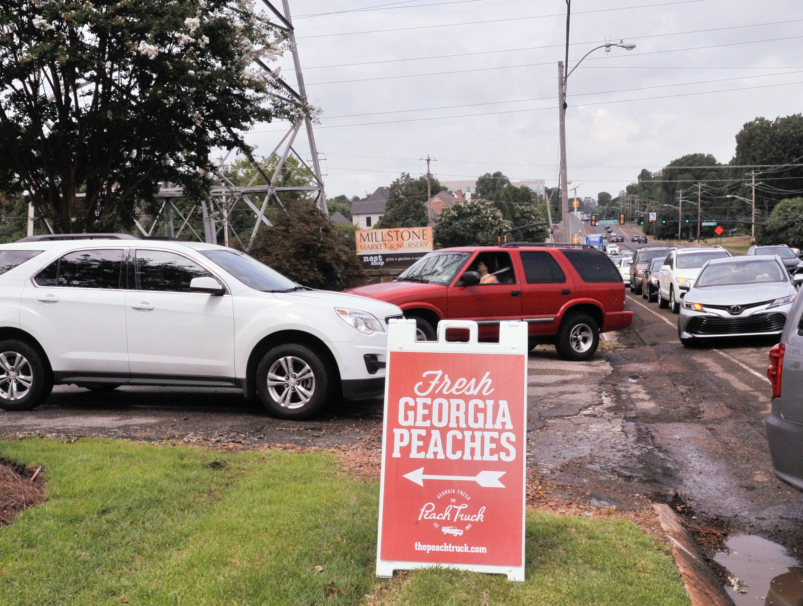 Traffic was backed up getting into Millstone Nursery for The Peach Truck on Wednesday.