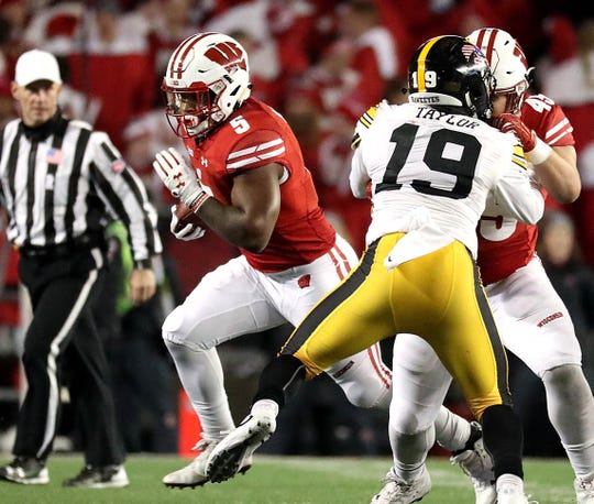 Badgers tailback Chris James finds a hole in a game against Iowa in 2017.
