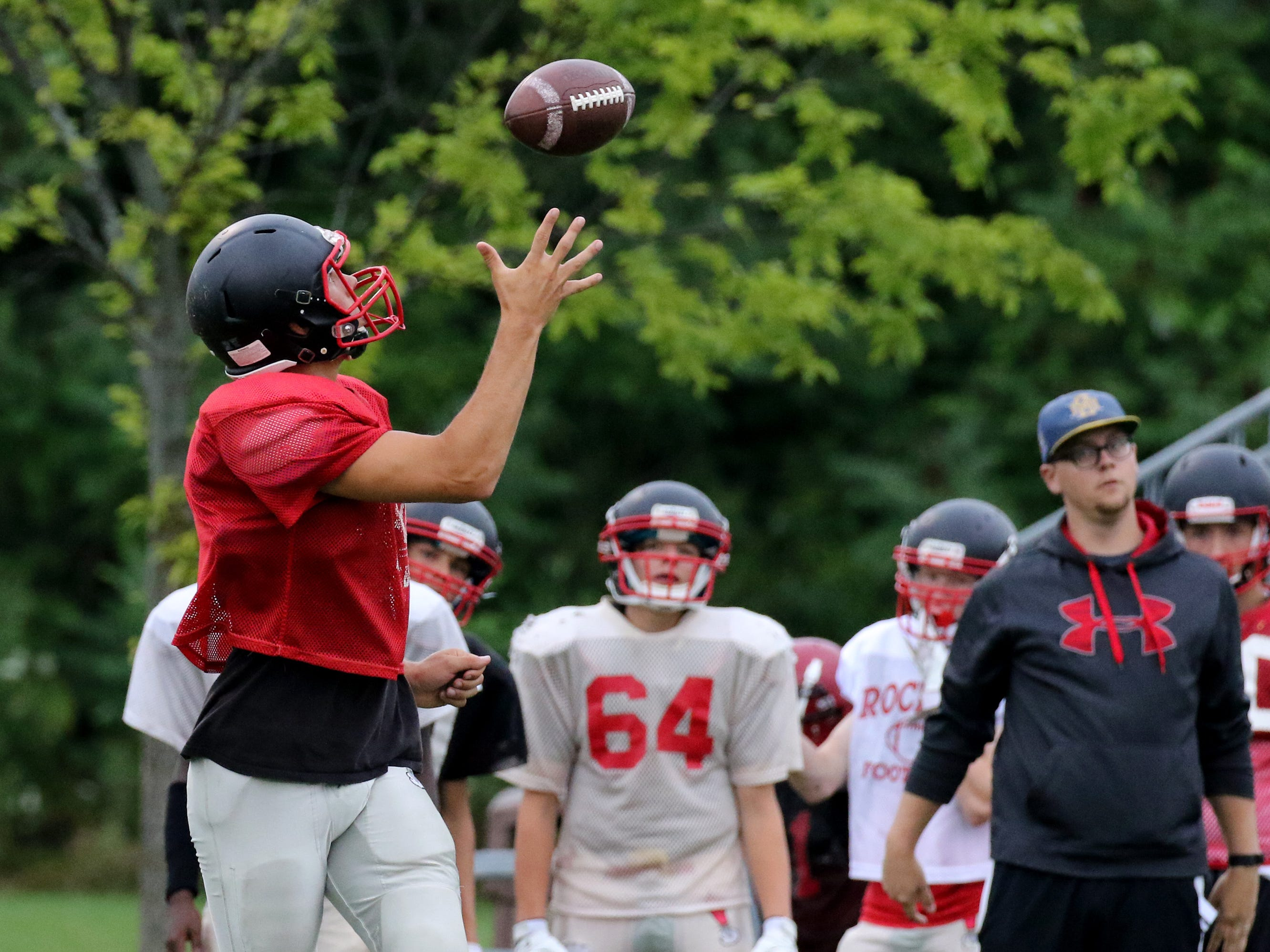 Recievers practice one-hand catches during South Milwaukee's Practice Night on Aug. 7 at South Milwaukee High School.
