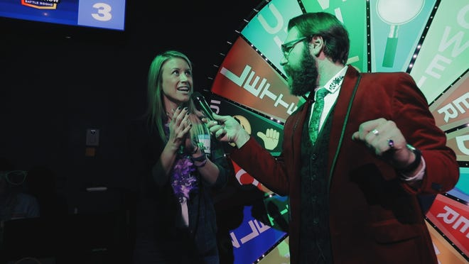 Host Michael Wesely quizzes a contestant at Game Show Battle Rooms in suburban Minneapolis. The business, which started just 10 months ago, is adding a second location, in Brookfield.