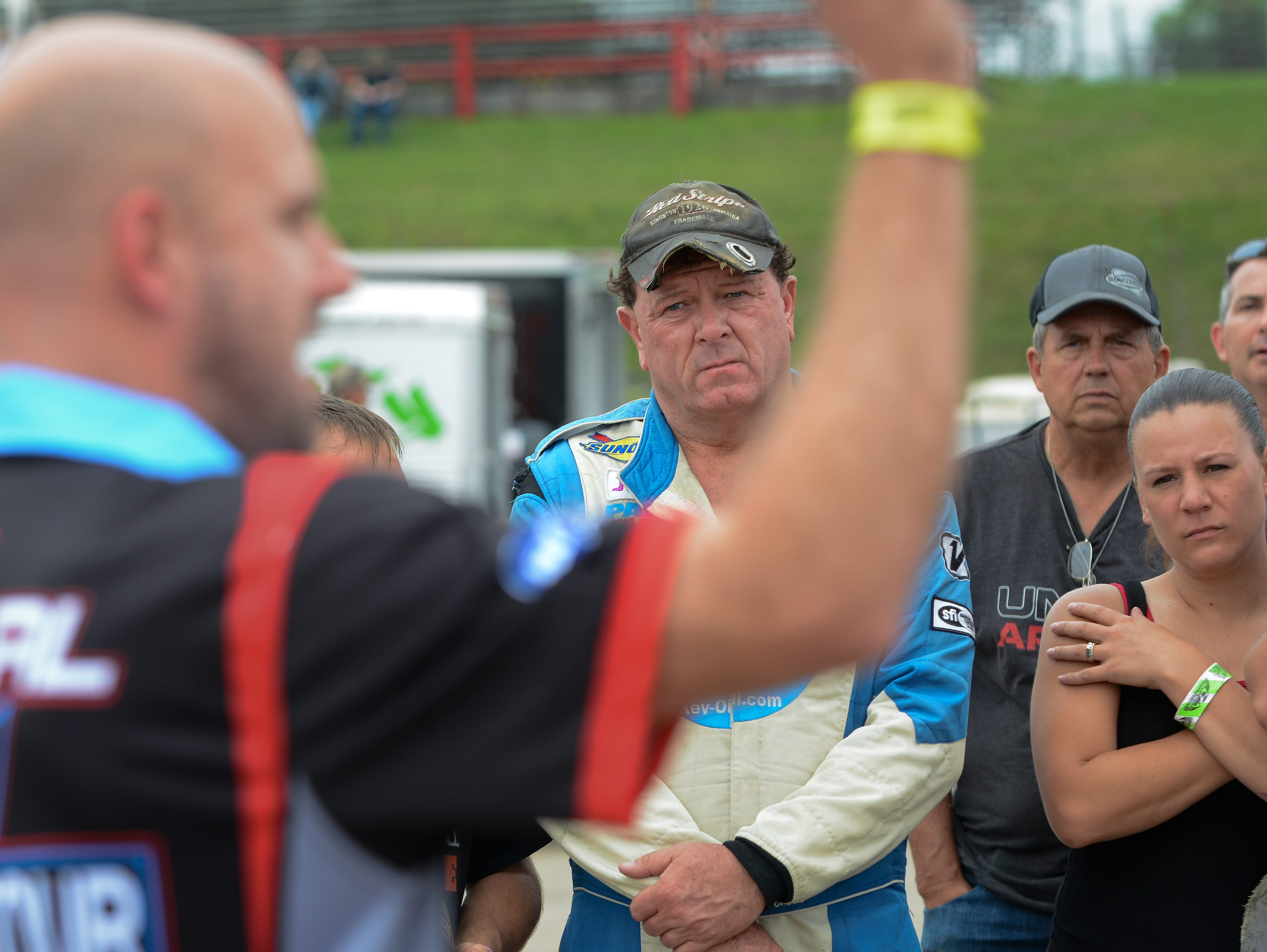 Rich Bickle listens to race director Nick Schumacher during the drivers meeting before the ARCA Midwest Tour Dixieland 250 on Tuesday, August 7, 2018, at Wisconsin International Raceway in Kaukauna, Wis.