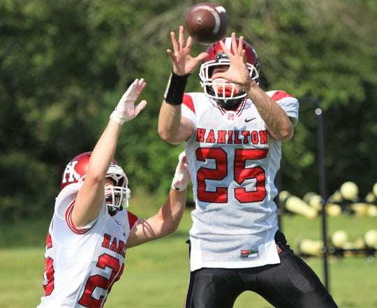 Sussex Hamilton junior Lucas Finnessy hauls in a pass during practice while Tycen Schauer attempts to break it up on August 8.