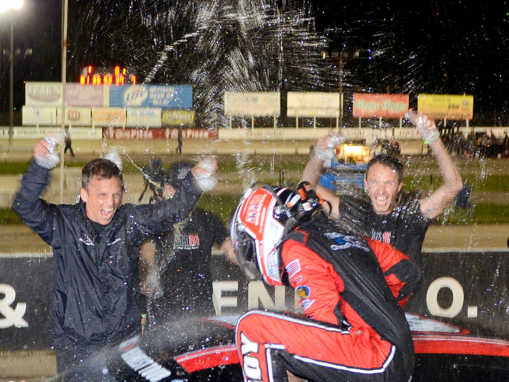 Chase Purdy's crew douse him after his victory in the ARCA Midwest Tour Dixieland 250 on Tuesday, August 7, 2018, at Wisconsin International Raceway in Kaukauna, Wis.
