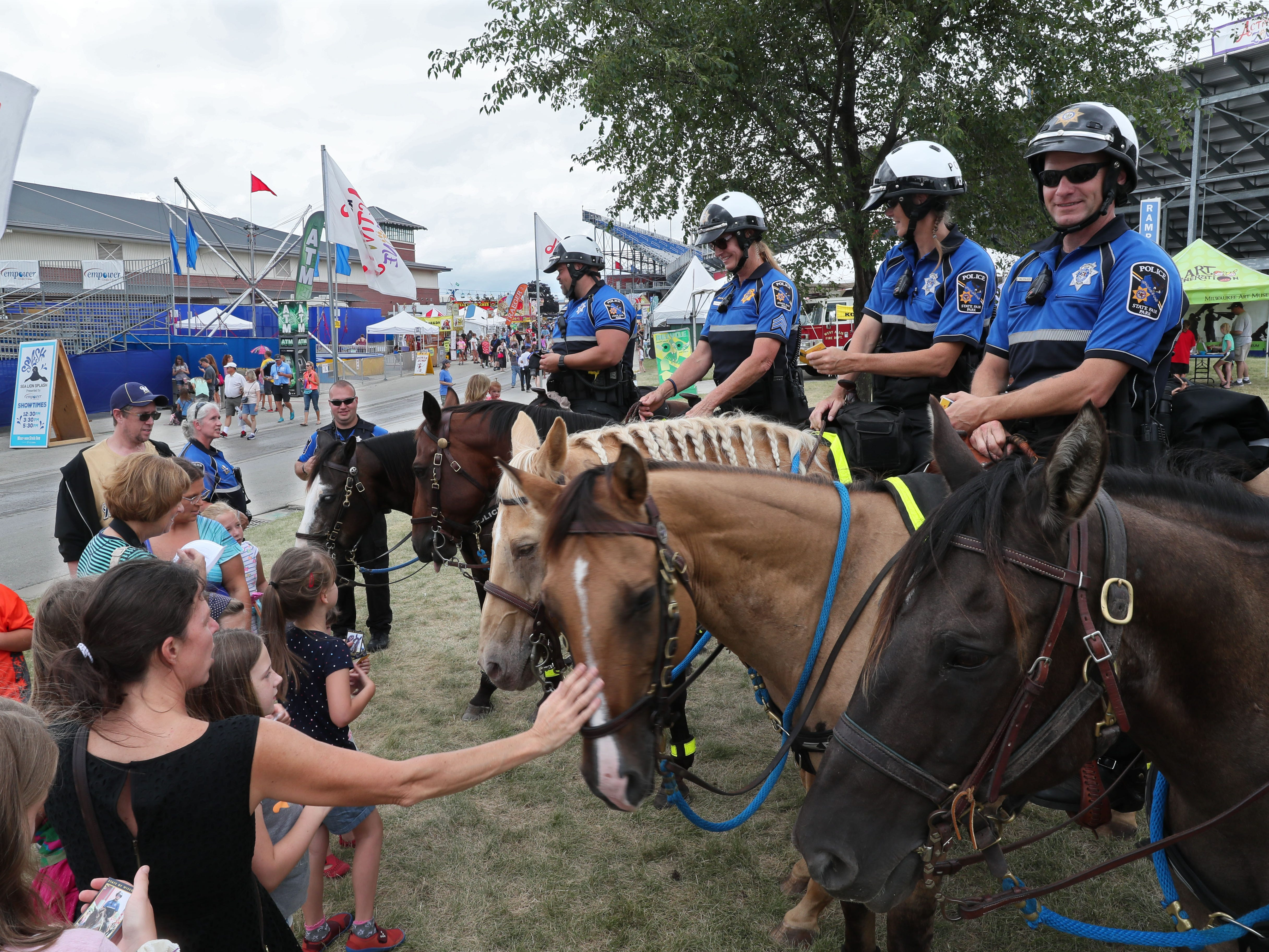 It's the 50th anniversary of the Wisconsin State Fair's mounted police patrol. The riders take time out from patrolling the fair to lead the daily parade and afterward people take time to get to know the officers and their horses.