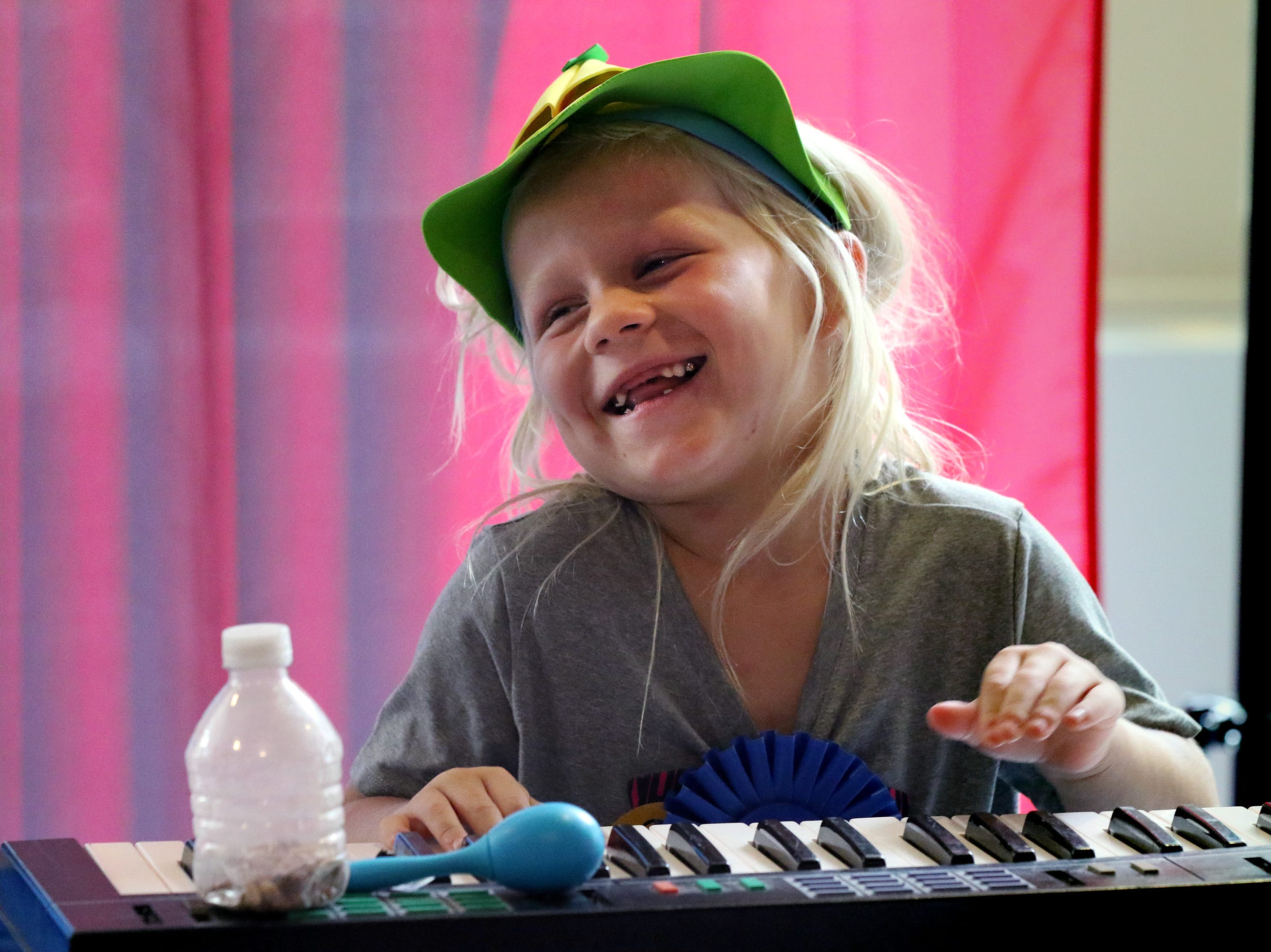 Skyler Mueller of Juneau plays piano in an all-kids band as a part of Nick's All Kid Show during State Fair at Children's Hospital on Aug. 7.