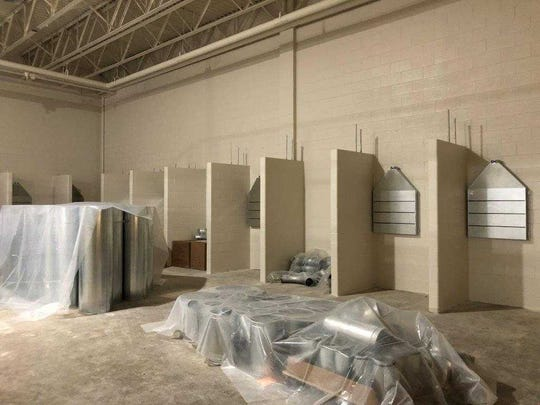 Duct work is being installed for the welding booths in the applied engineering and technology area of Hamilton High School.