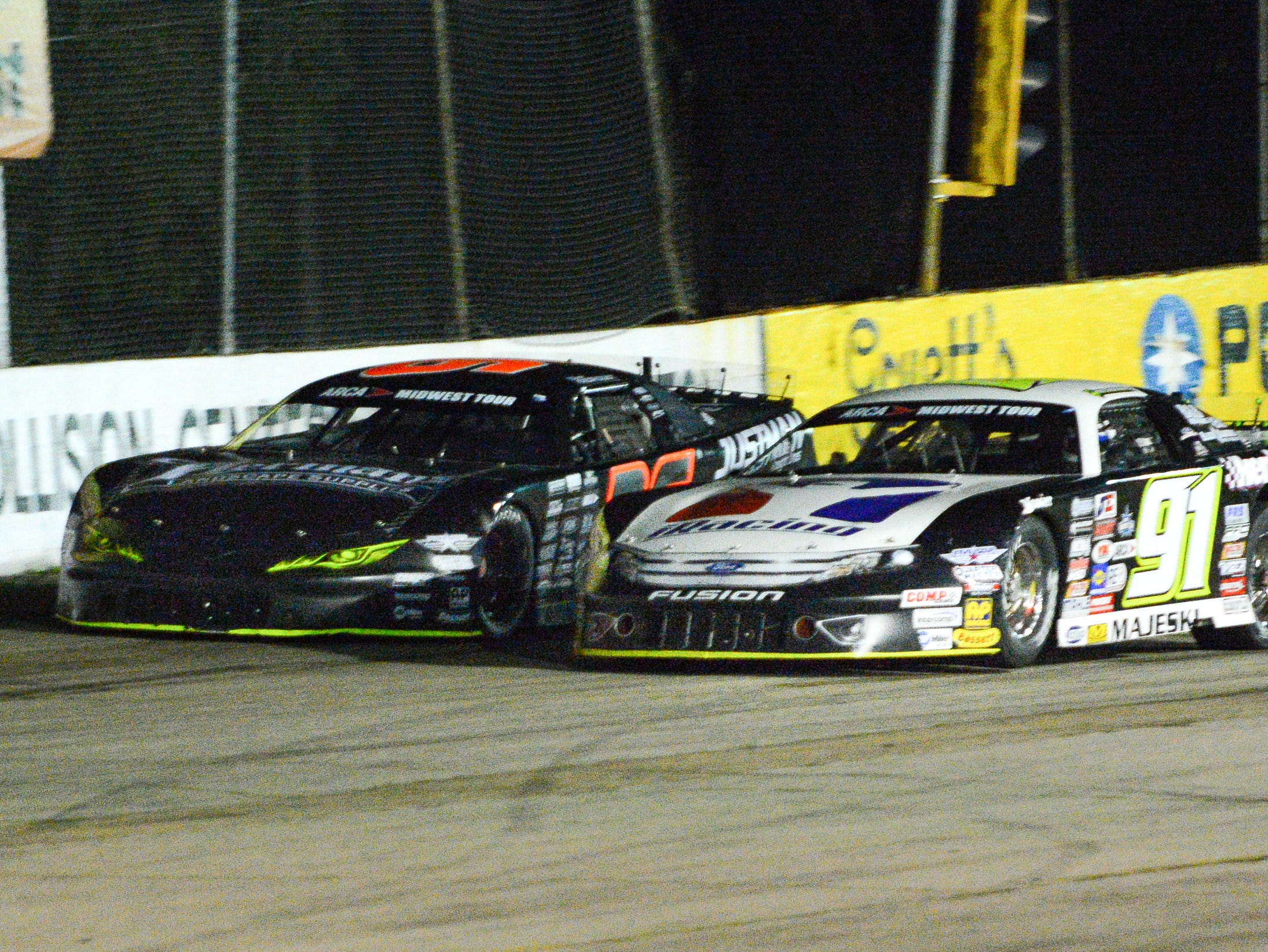 Dan Fredrickson (left) and Ty Majeski battle for the lead early in the ARCA Midwest Tour Dixieland 250 on Tuesday, August 7, 2018, at Wisconsin International Raceway in Kaukauna, Wis.