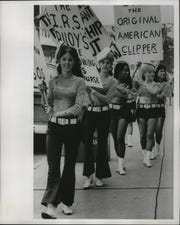 Waitresses at the Nauti-Gal nightclub, which was closed by the Internal Revenue Service the week before for nonpayment of withholding taxes, picket the IRS offices at the Federal Building on Aug. 19, 1968. This photo was published in the Aug. 20, 1968, Milwaukee Sentinel.