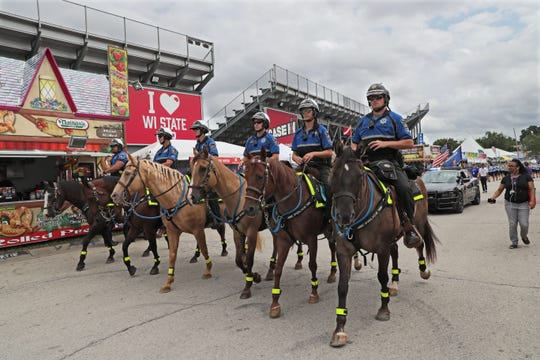 The Wisconsin State Fair's mounted police patrol take time out from patrolling the fair to lead the daily parade.